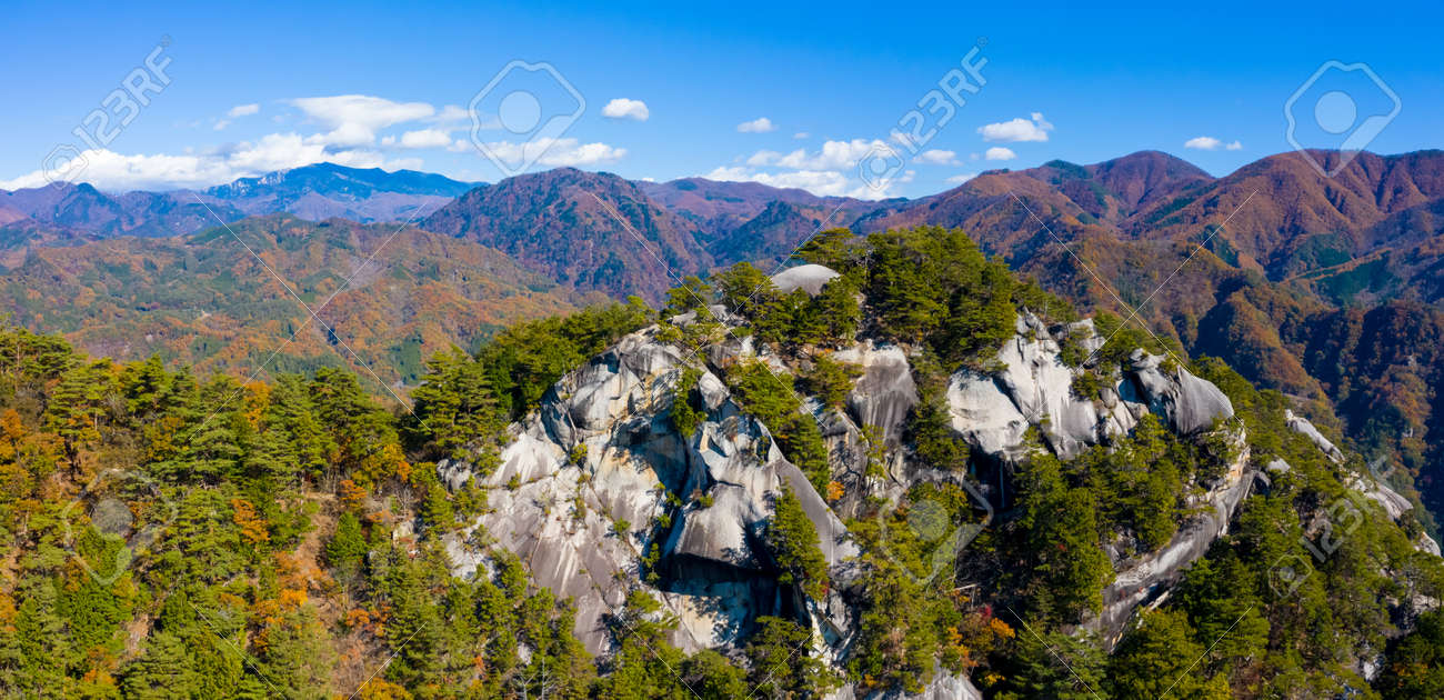 Panorama of Japan from a height. Park, a gorge in Japan. Japanese mountain landscape. Mountains and coniferous trees on the rocks. Nature Of Japan. - 154755042