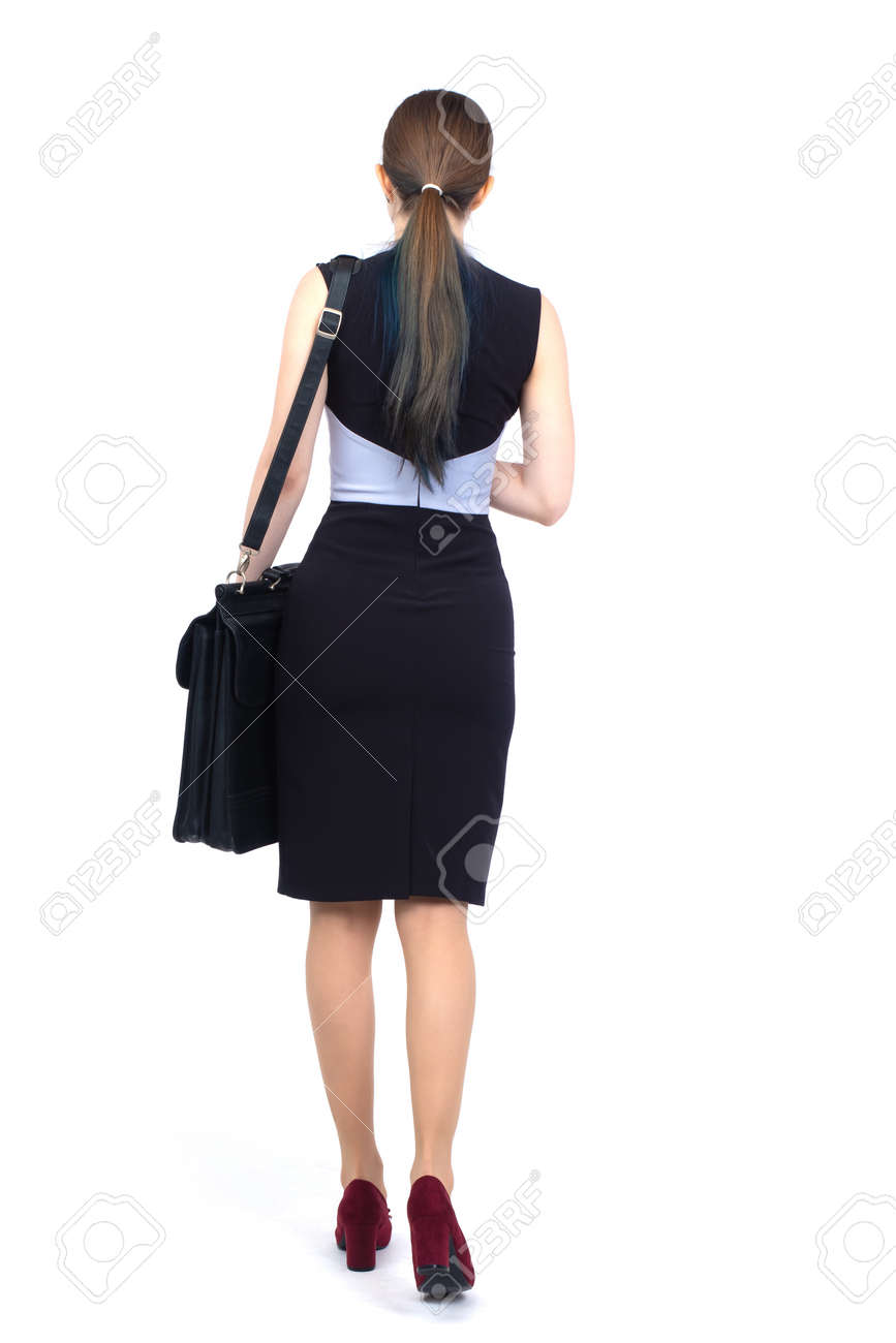 Woman dressed in business style back view. Businesswoman in full growth from back. Woman in a business skirt on a white background. Concept - she goes somewhere. Businesswoman with a briefcase. - 159466895