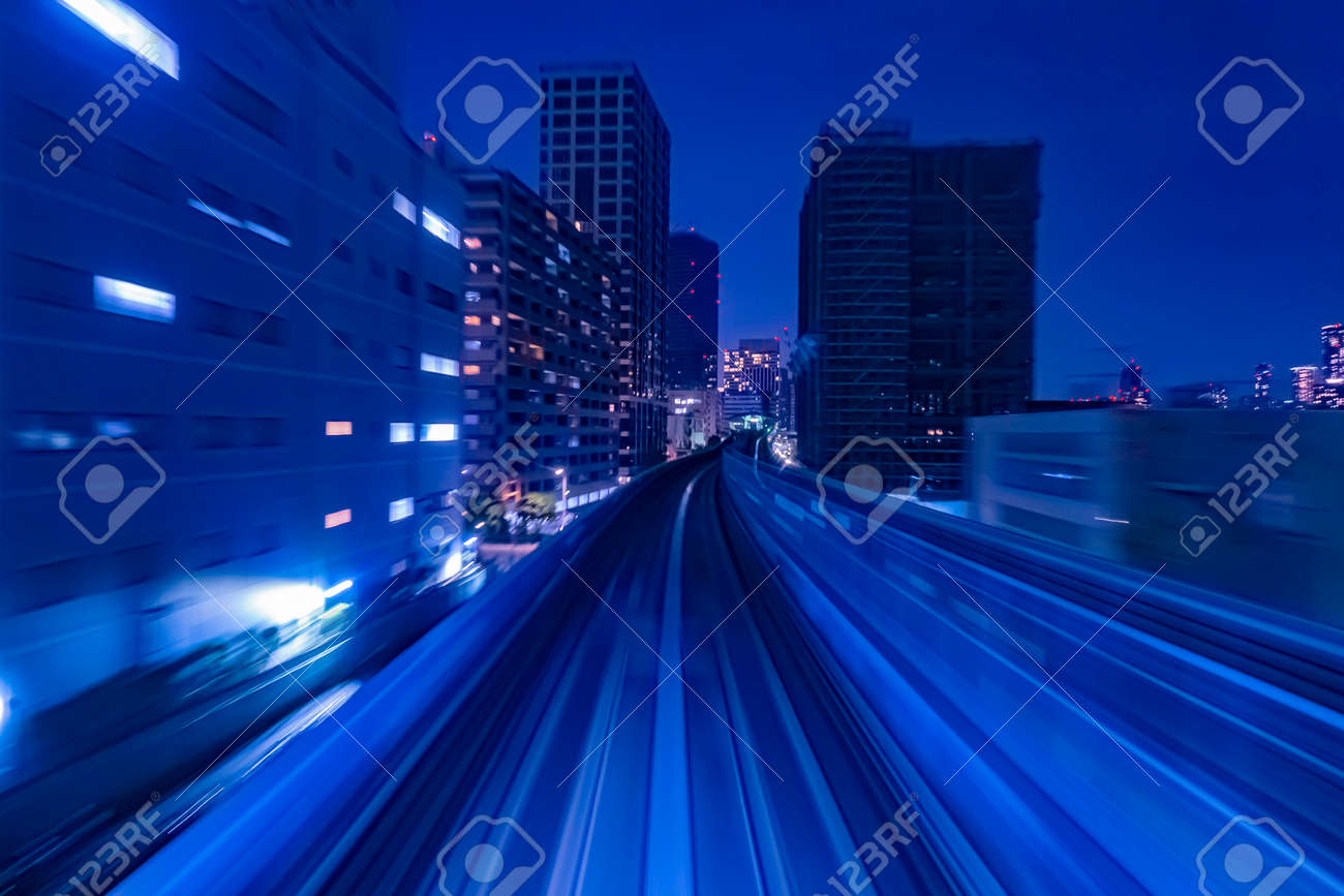 Japan. Railway in Tokyo. Flyover for trains in the evening. Concept - rails for high-speed trains. Concept - travel on high-speed trains. Tokyo cityscape. The capital of Japan in the evening - 167227920