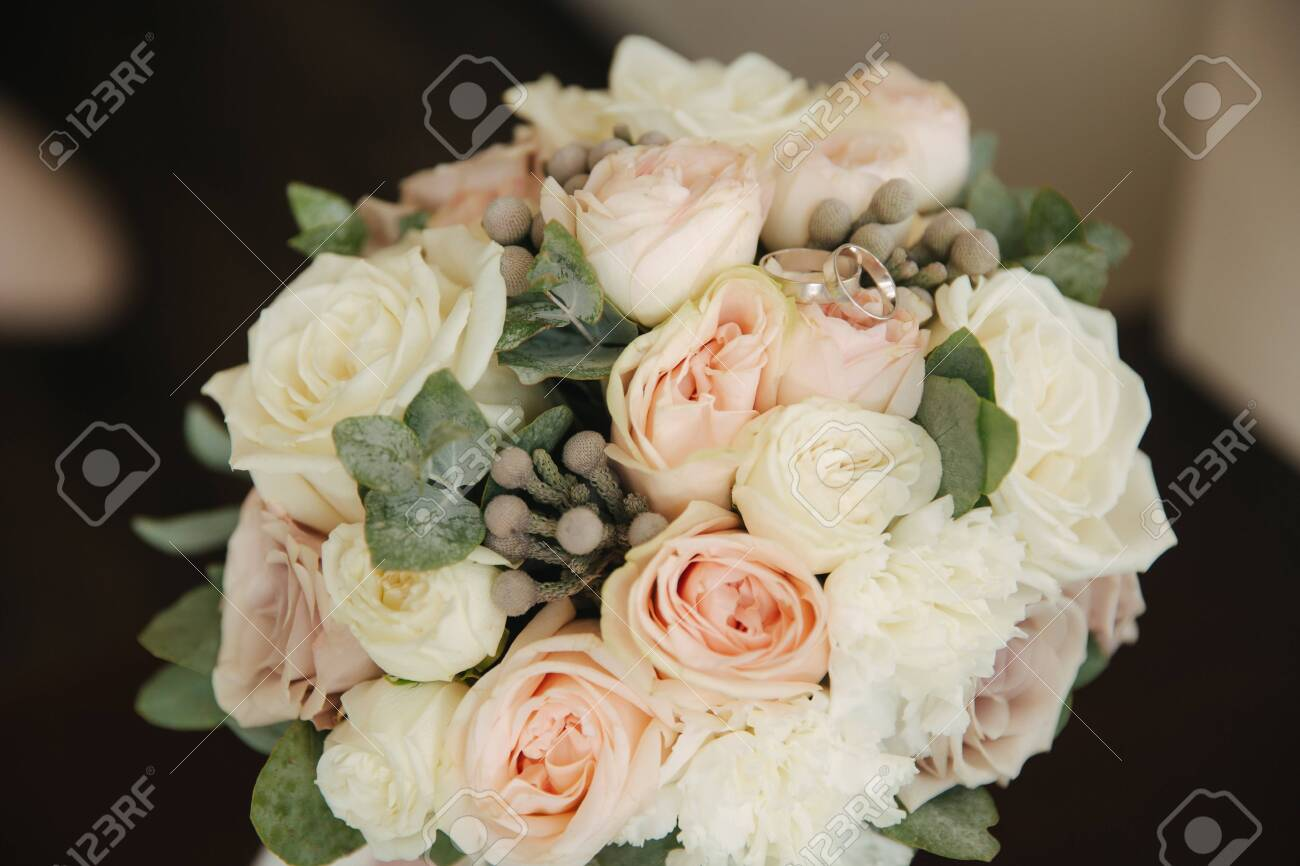 White Gold Rings On Wedding Bouquet Flowers Stock Photo Picture And Royalty Free Image Image 128610927