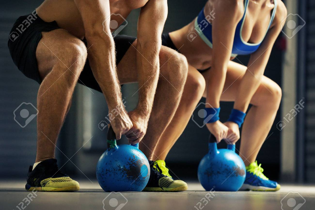 Fit man and woman training by kettle bell. - 63086051