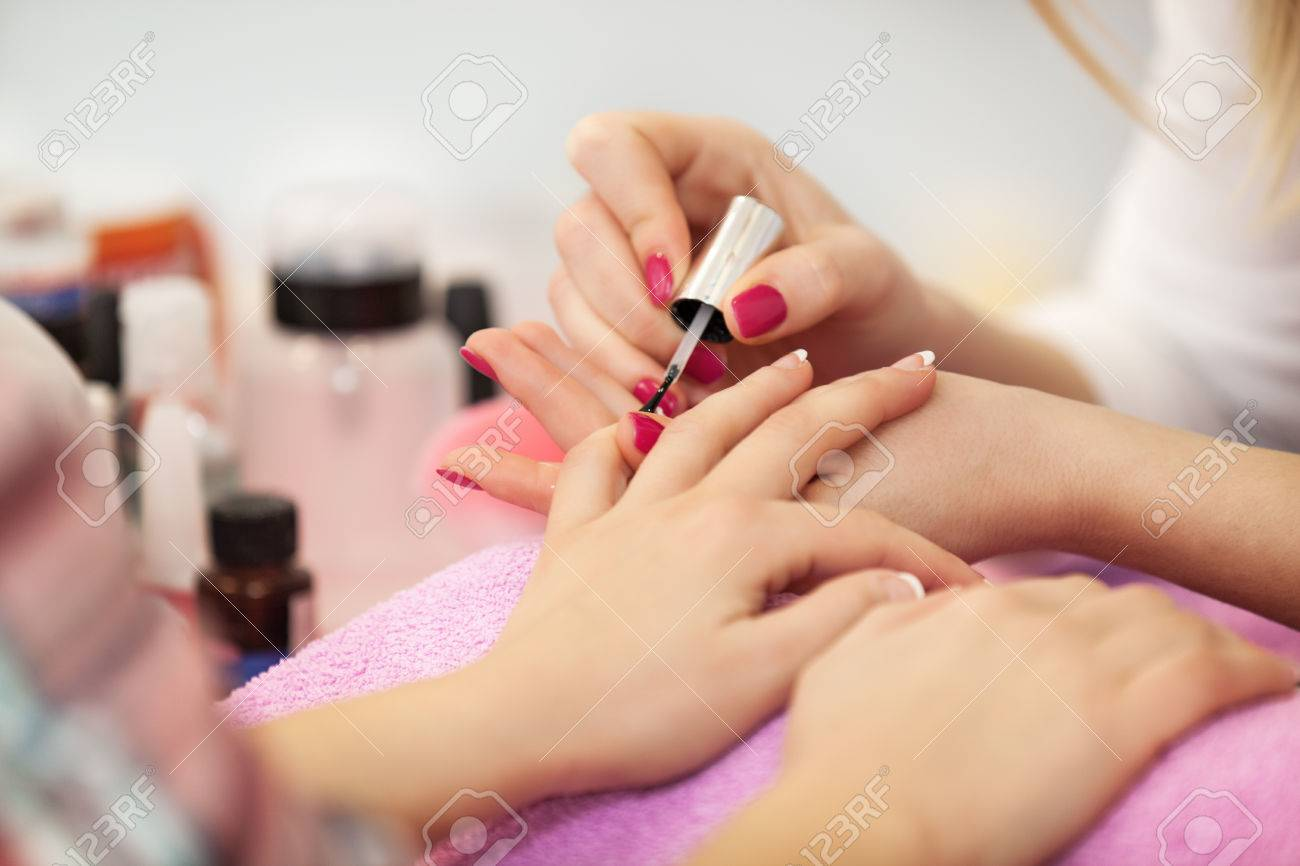 Finiching French Manicure. Nail Polishing. Close Up. Stock Photo ...