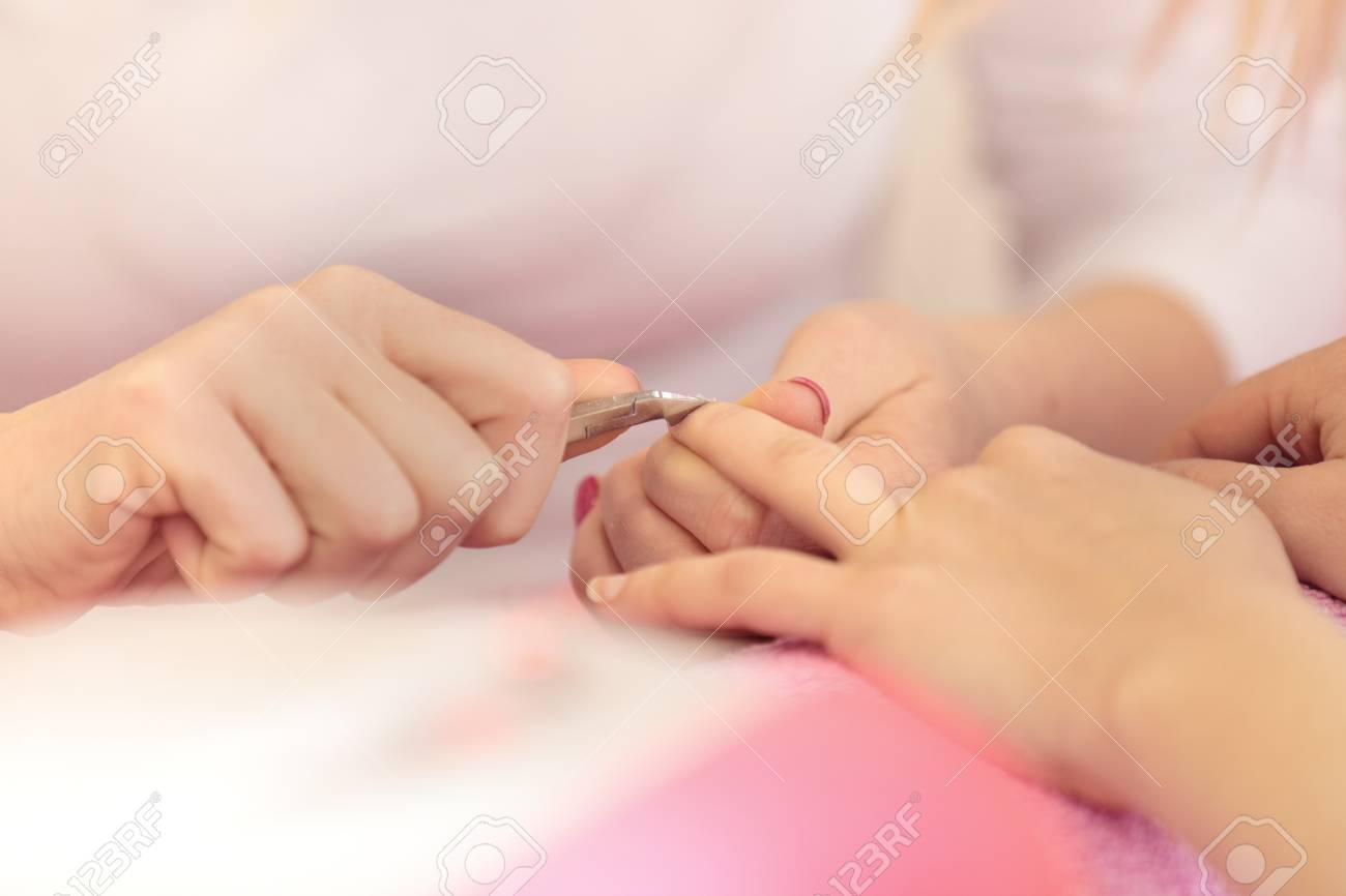 Woman Hands Receiving Manicure And Nail Care Procedure. Close ...