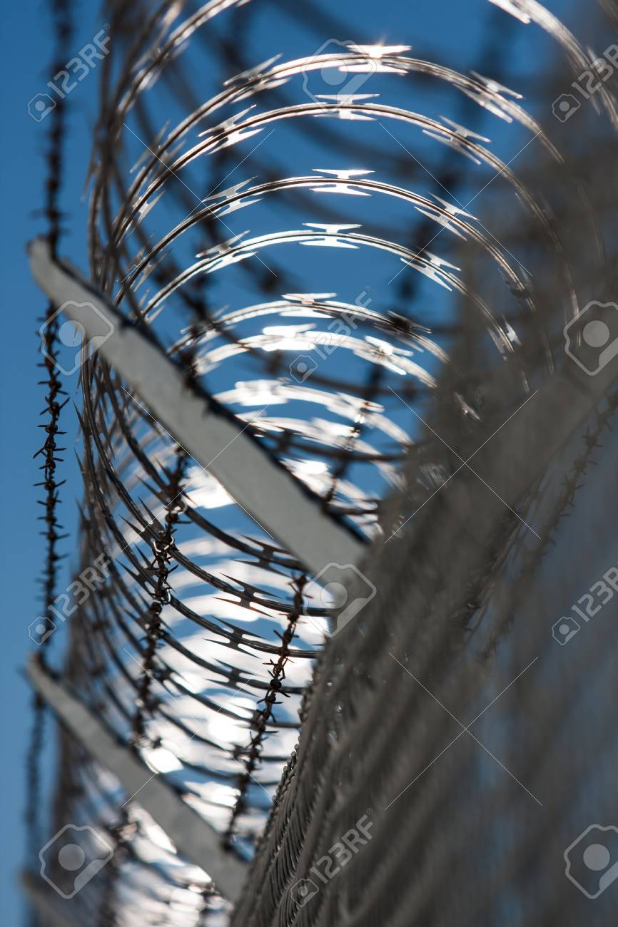 A Fence Topped With Concertina Razor Wire Stock Photo, Picture And ...