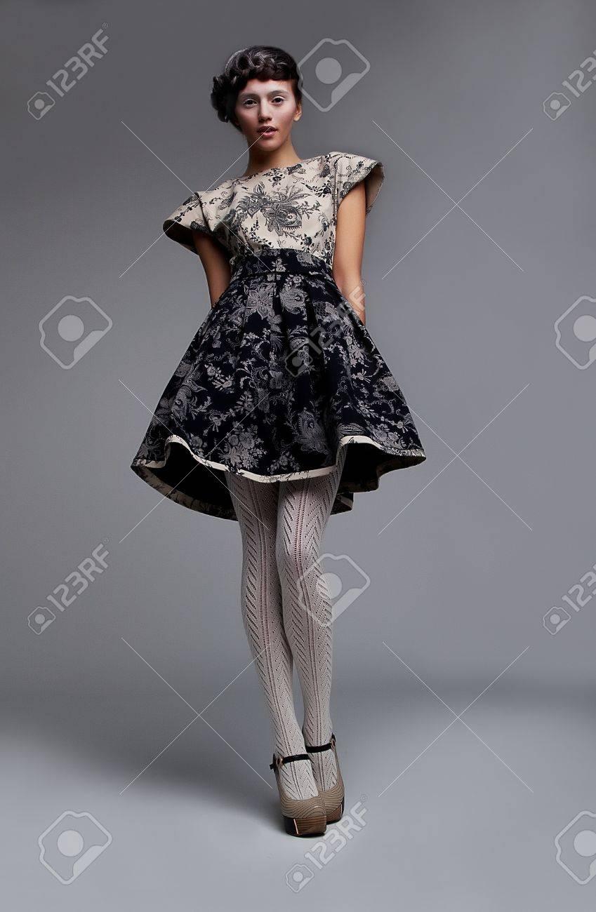 Supermodel fashionable brunette standing in grey  dress Stock Photo - 11865136