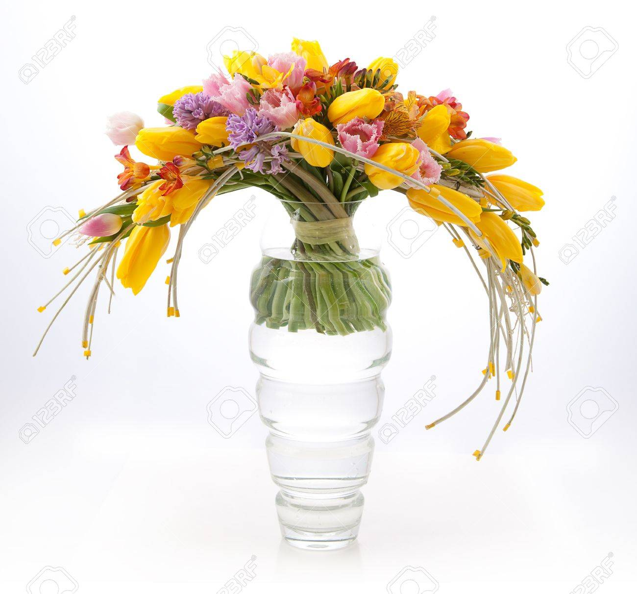 Floristics - colorful vernal flowers bouquet arrangement in vase isolated on white Stock Photo - 12433226