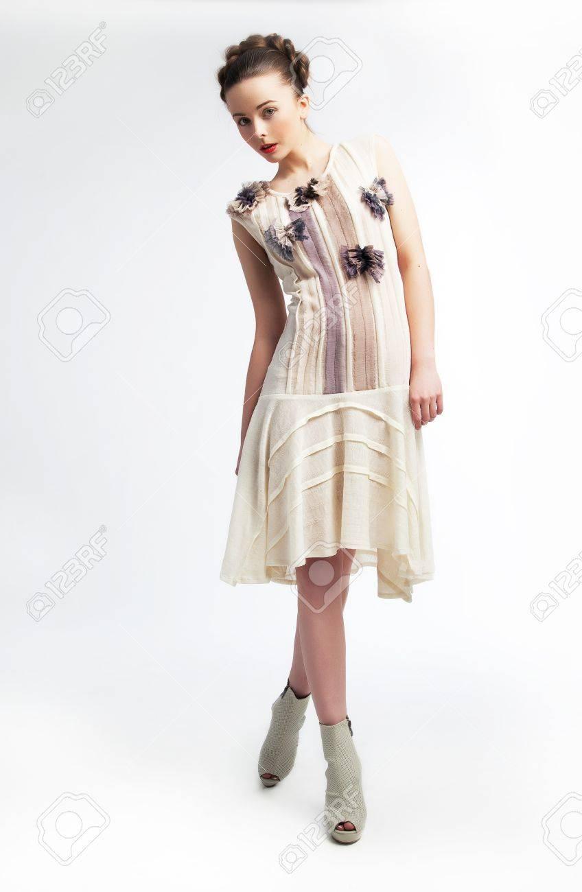 Beautiful fashionable young woman in white dress posing  Beauty  Fashion Stock Photo - 12433636