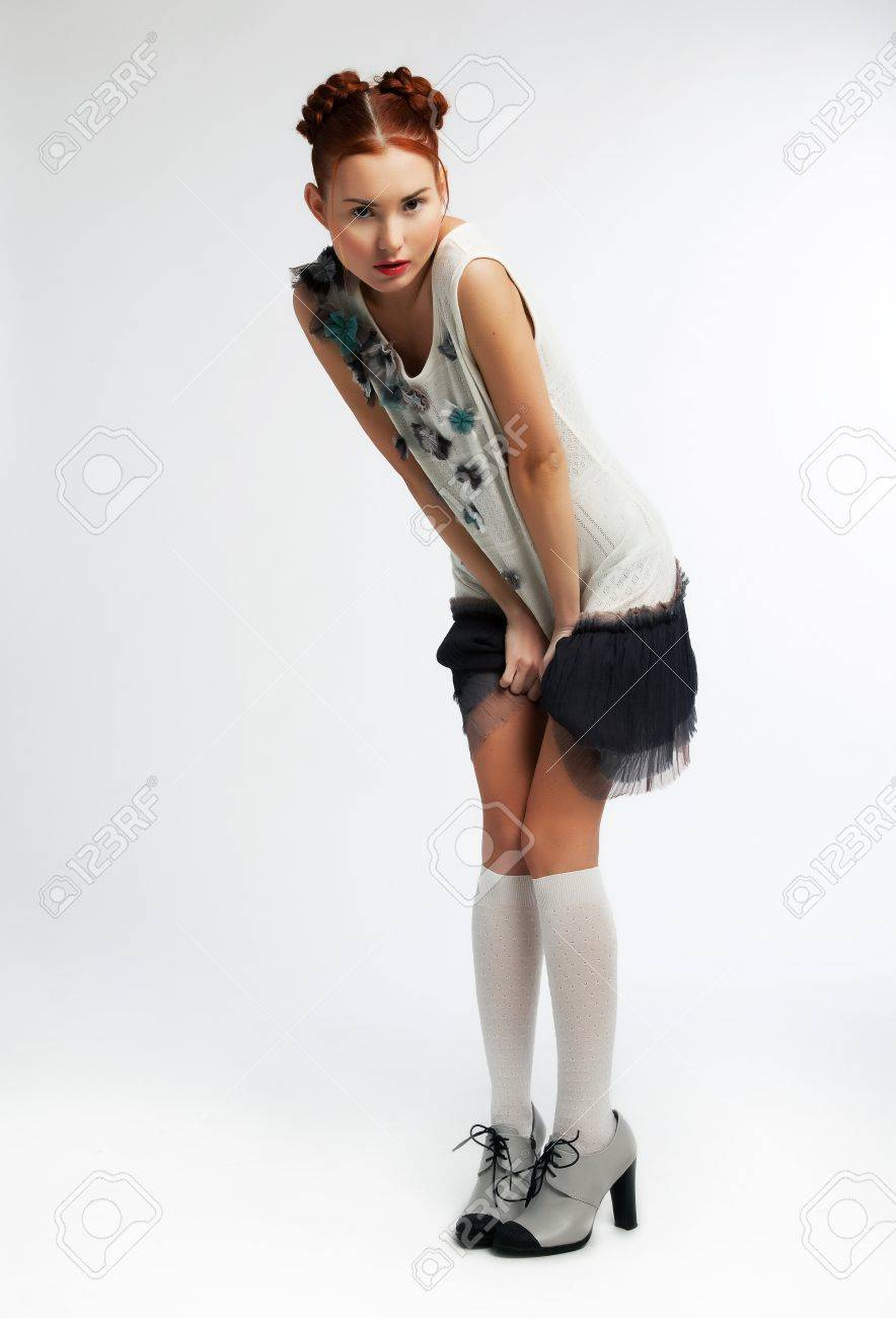 Stunning asian redhead girl  wearing modern dress  Studio shot Stock Photo - 12433601