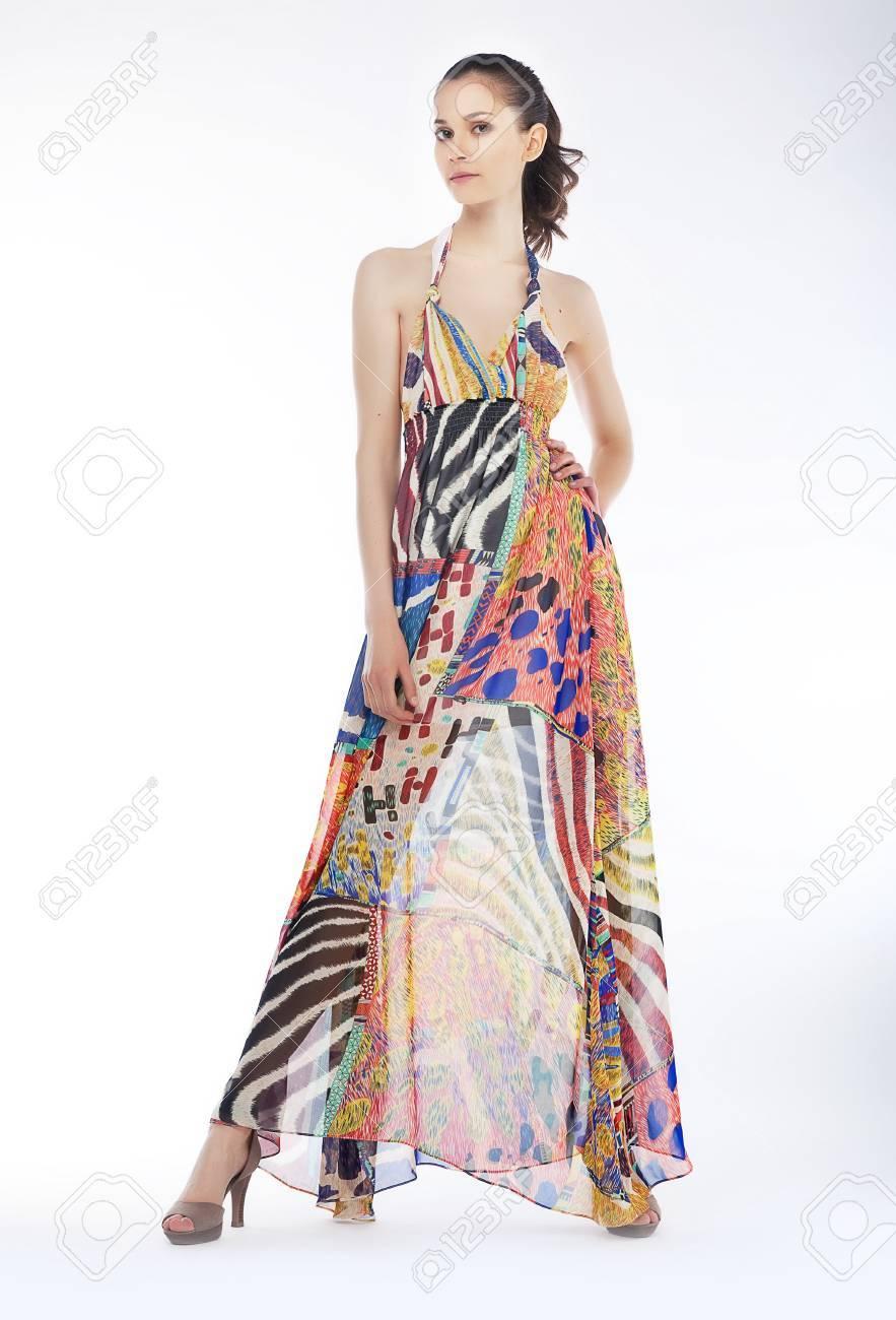 Fashionable beautiful woman wearing cream satin cocktail dress - fashion style Stock Photo - 13714202