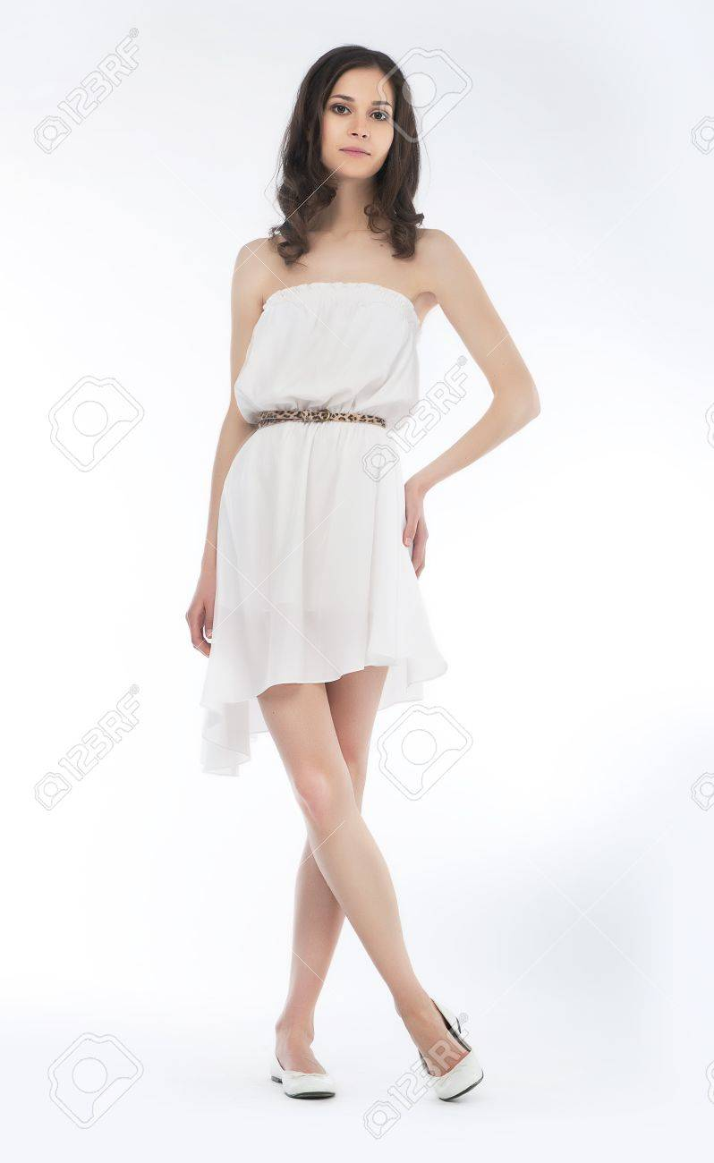 Young charming female in summer dress posing over white background Stock Photo - 13778412