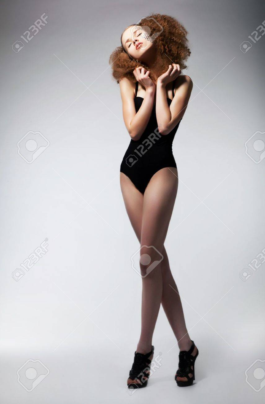 Full length of a pretty young redhead woman in black bikini  posing over white background Stock Photo - 13998817