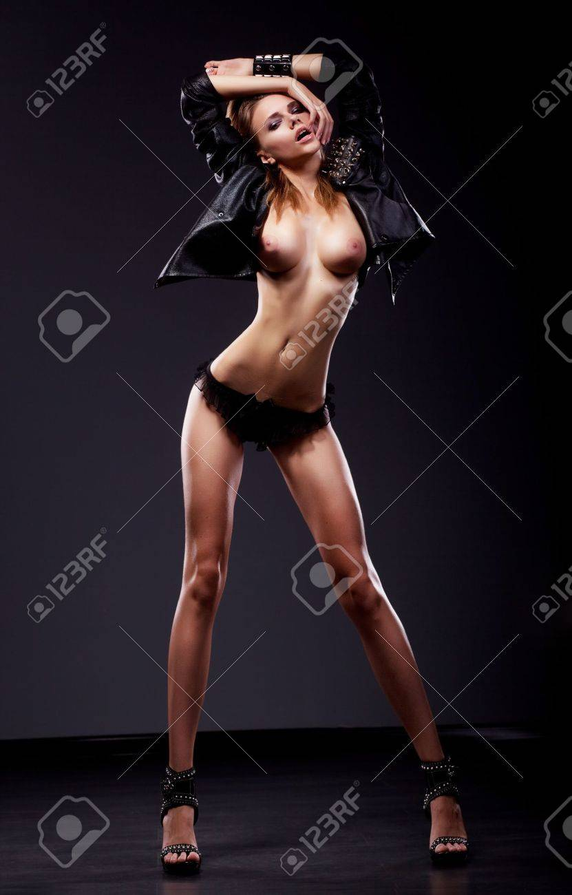 passion flirt sexy brunette naked slim woman posing in black.. stock