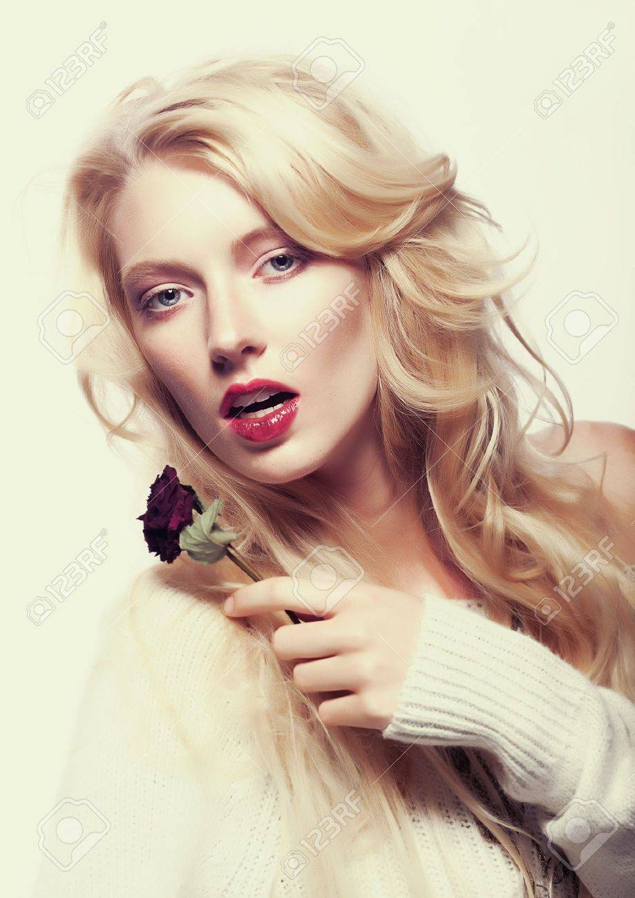 Sexy woman blonde with flower - red rose Flowers  Sepia vintage toned Stock Photo - 14882194