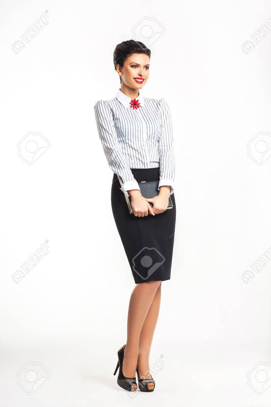 Beautiful smiling happy woman with book standing in studio Stock Photo - 16237264
