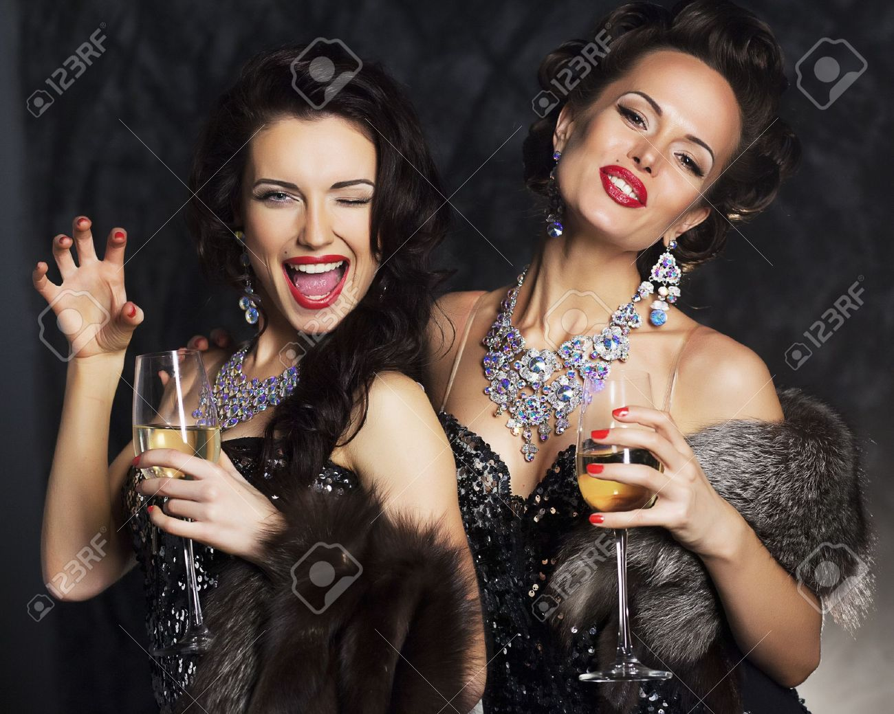 Young women in black elegant dress holding goblets with wine - nightlife Stock Photo - 16319019