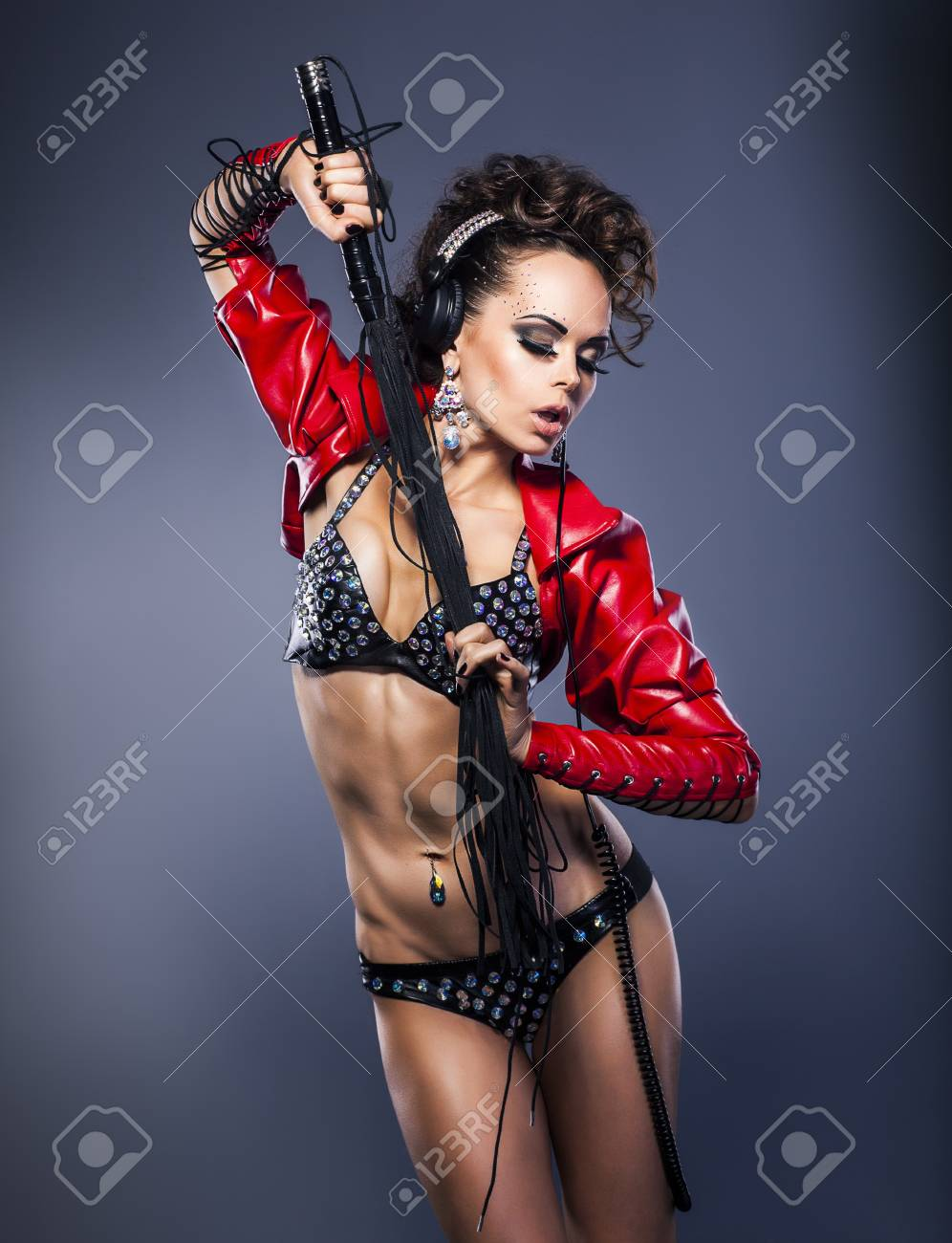 Fancy brutal woman in erotic underwear with lash - glamour Stock Photo - 16318978