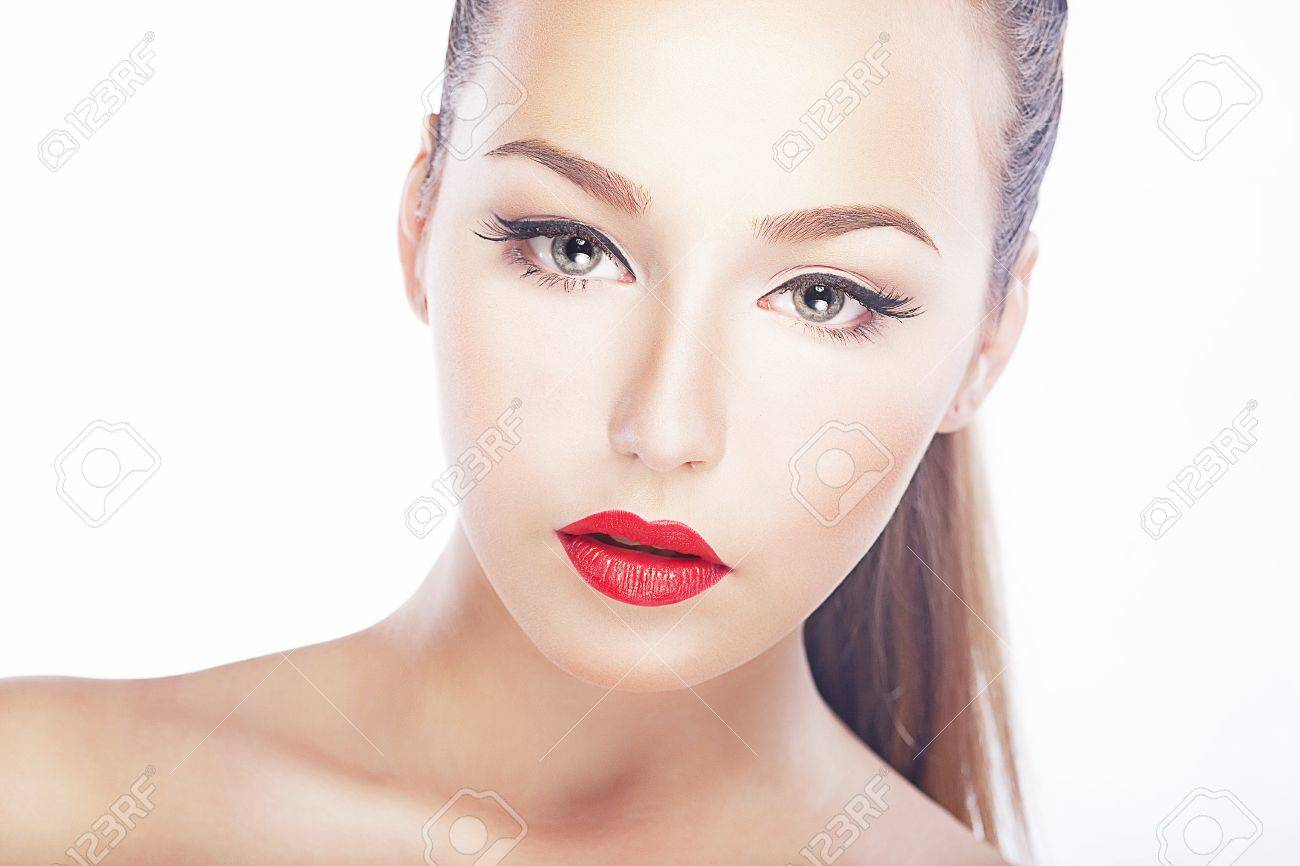 Pure beauty. Luxurious woman face - red lips, natural clean healthy skin Stock Photo - 16614371