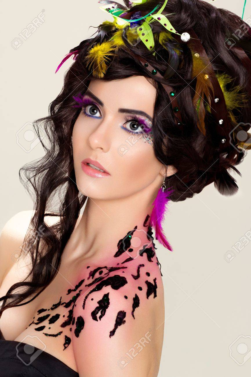 Futuristic luxury hairdo. Bright makeup and tattoo. Fancy beauty woman Stock Photo - 16614385