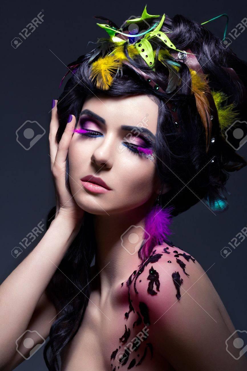 Fantasy  Fashion Female with Colorful Feathers - Bright Makeup  Creativity  False Eyelashes Stock Photo - 16673278