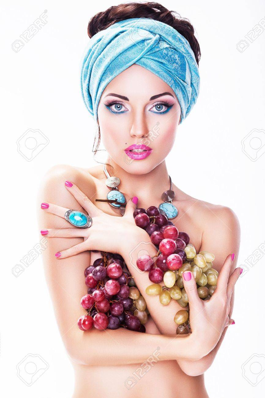 Girl with Winegrapes  over White background Stock Photo - 16854841