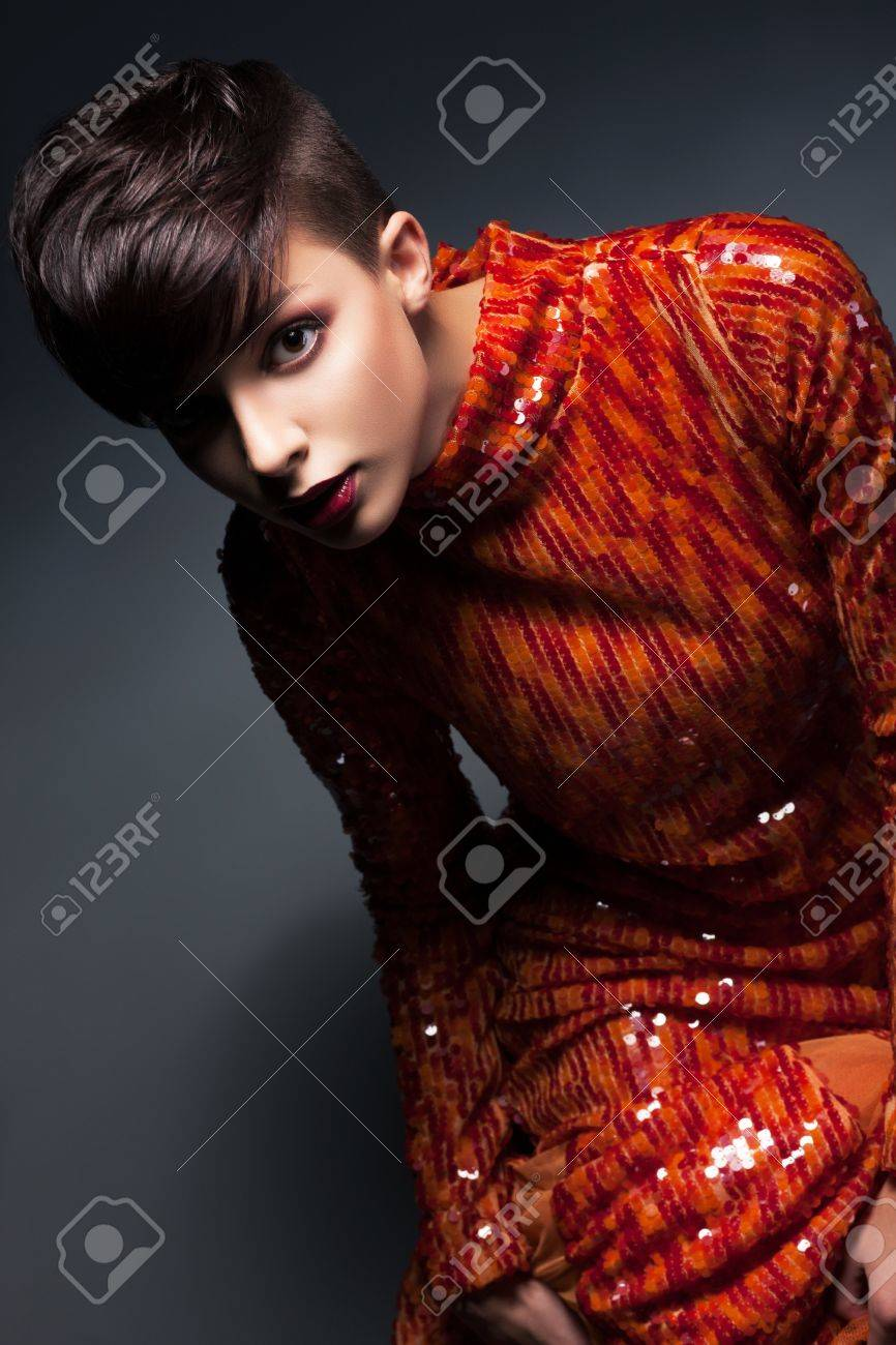 Charm  Chic Young Woman in Red Evening Gown posing Stock Photo - 17156747