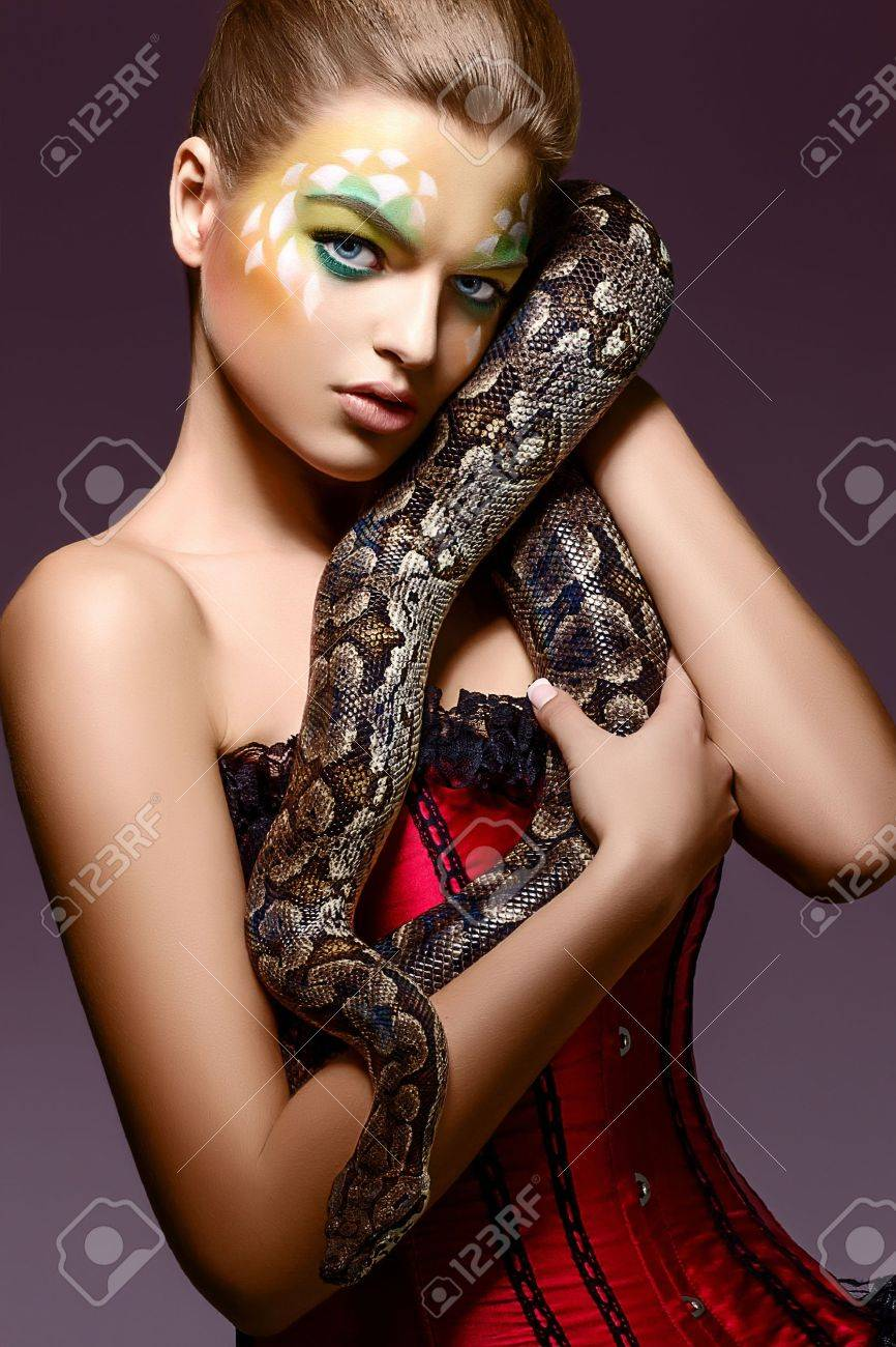 Beautiful Woman holding Python Snake in Hands - Performance Stock Photo - 17255252