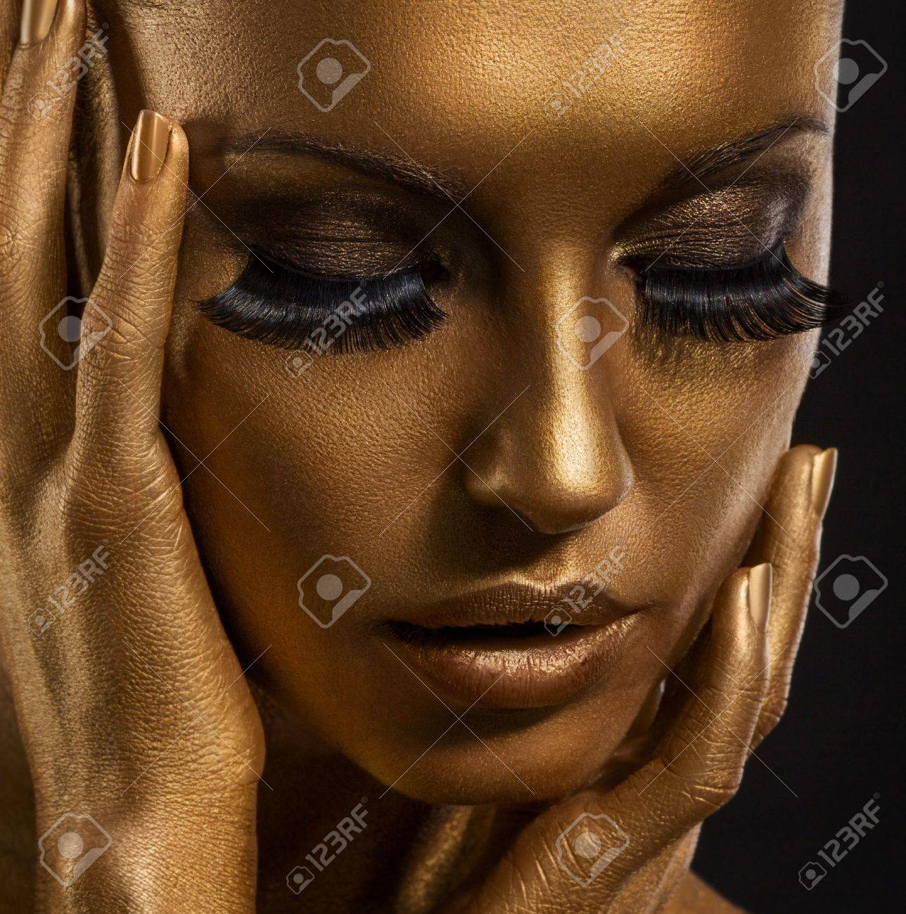 Gilt. Golden Woman's Face Closeup. Futuristic Giled Make-up. Painted Skin Stock Photo - 18462450