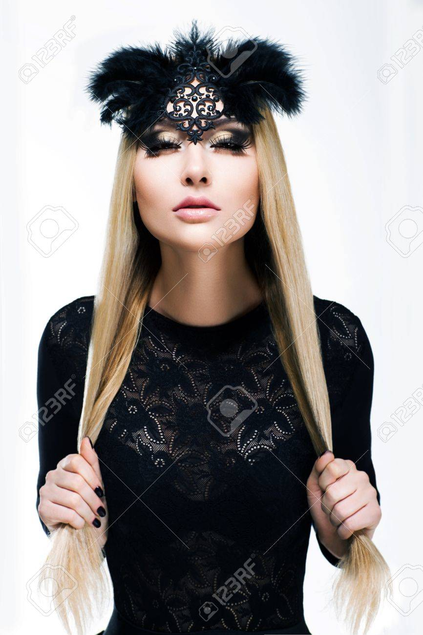 Portrait of Stylized Woman Blonde in Black Carnival Mask with Feathers. Holiday Stock Photo - 18382337