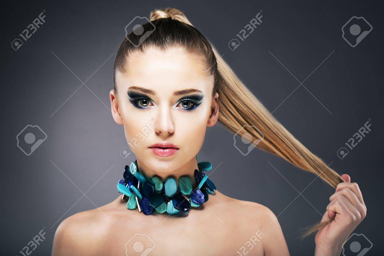 Treatment. Woman holding Tips of her long faint Hair in hand Stock Photo - 18499289