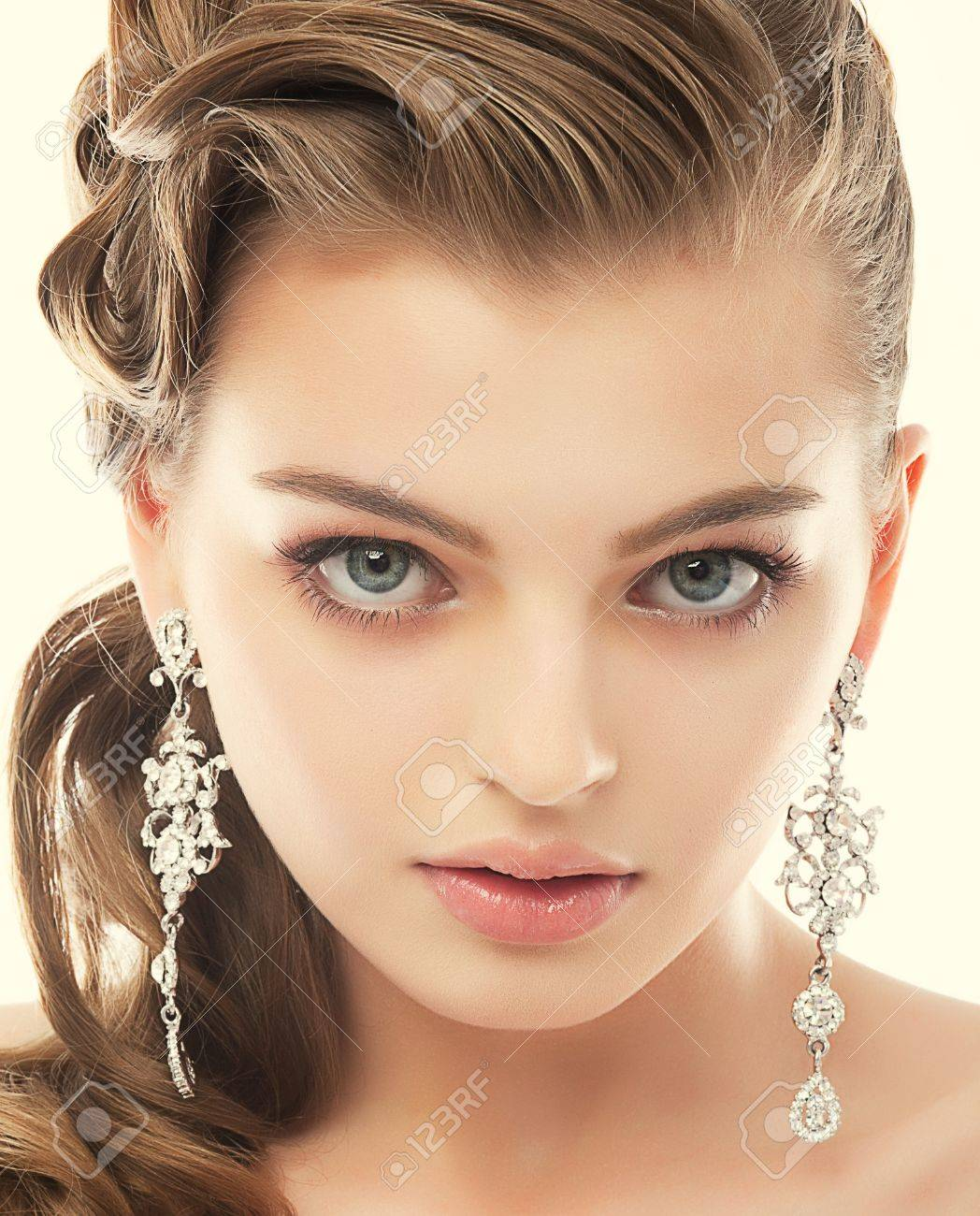 Jewelry. Portrait of Gorgeous Exquisite Woman with Shiny Earrings. Refinement Stock Photo - 19000253