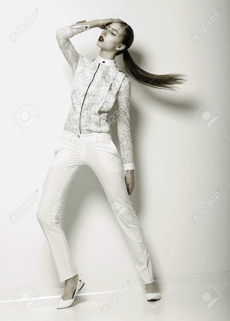 Expression. Futuristic Woman in White Trousers. Trend. Stock Photo - 19028381