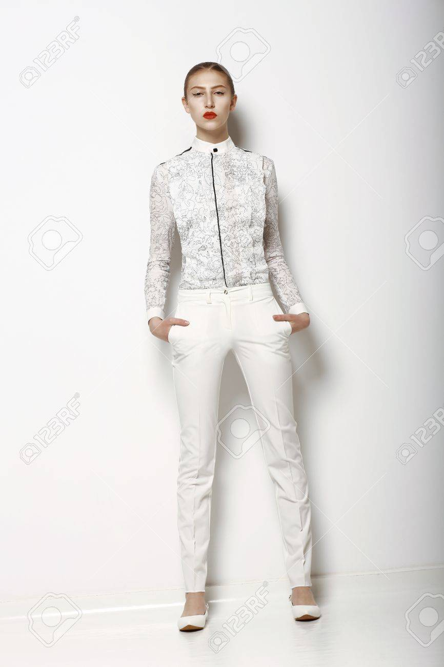 High Fashion. Trendy Woman in WHite Breeches in Graceful Pose. Spring Time Collection Stock Photo - 19024966