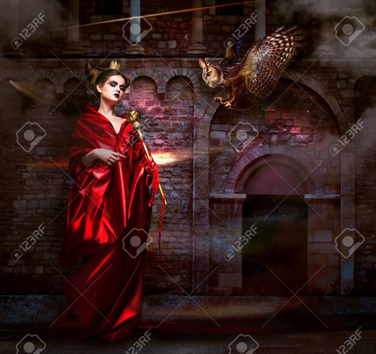 Mysticism   Witchcraft  Sorcerer in Red Mantle with Vulture - Hawk  Ancient Scary Castle Stock Photo - 19363480