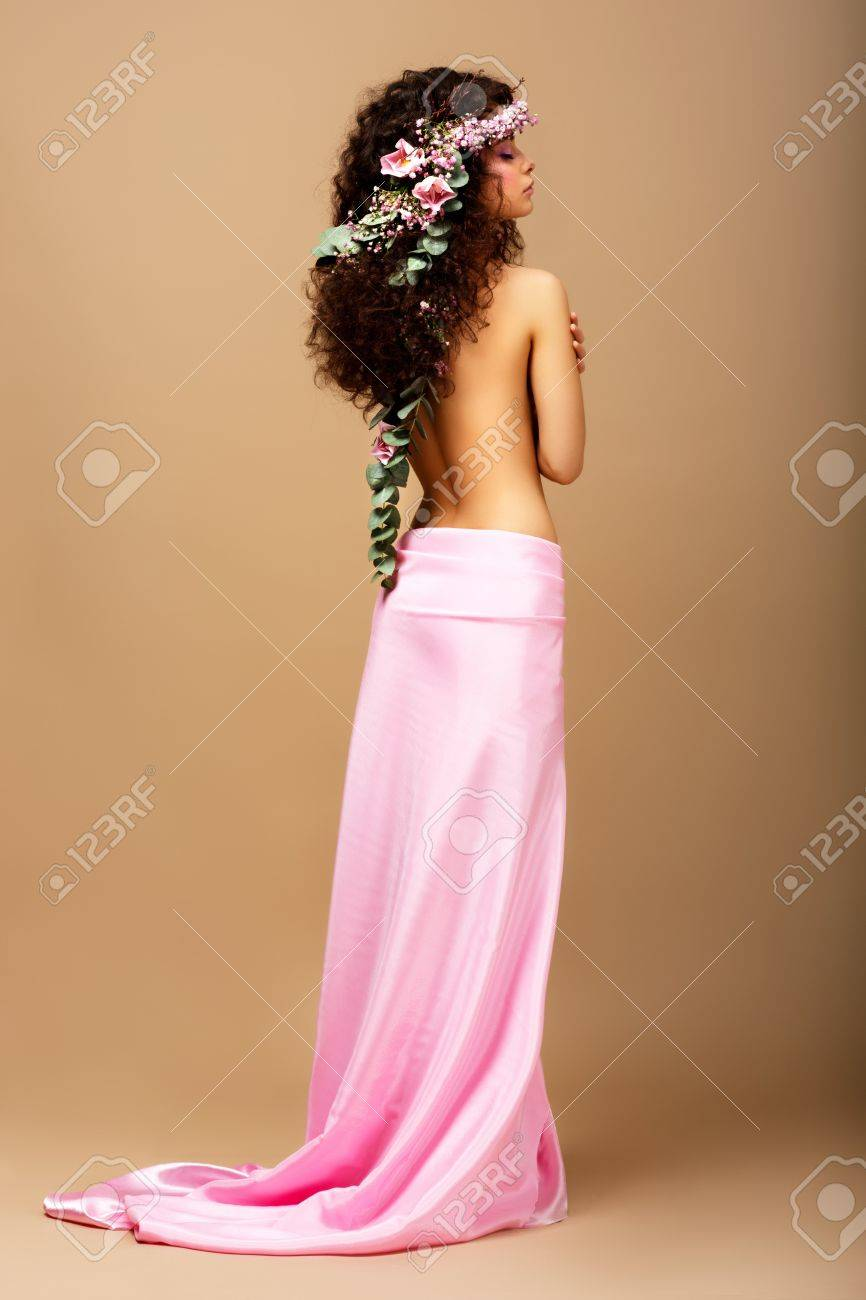 Freshness. Tenderness. Gorgeous Curly Hair Brunette with Wreath of Flowers Stock Photo - 20340970