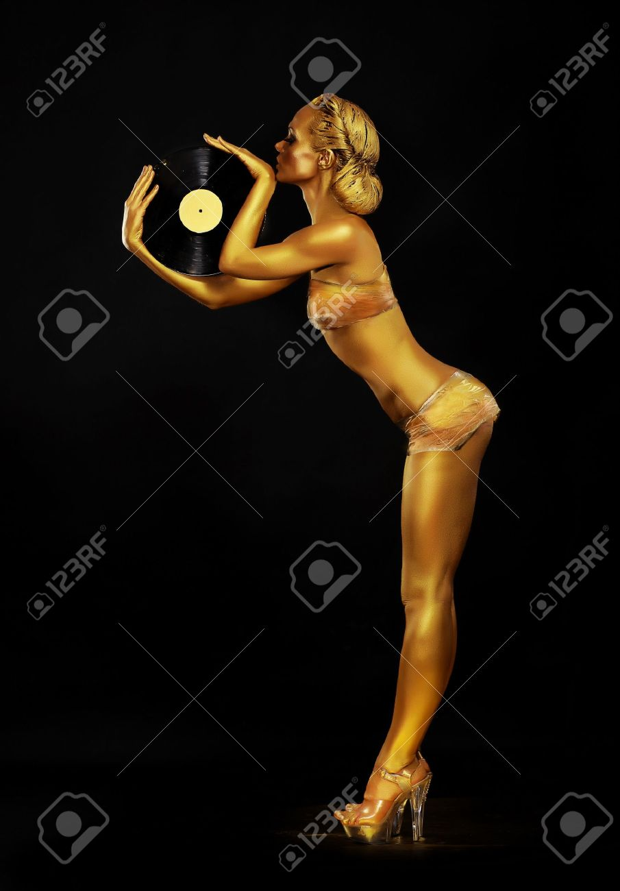 Futurism. Shapely Golden Woman DJ with Vinyl Record. Body Painting Stock Photo - 21001564
