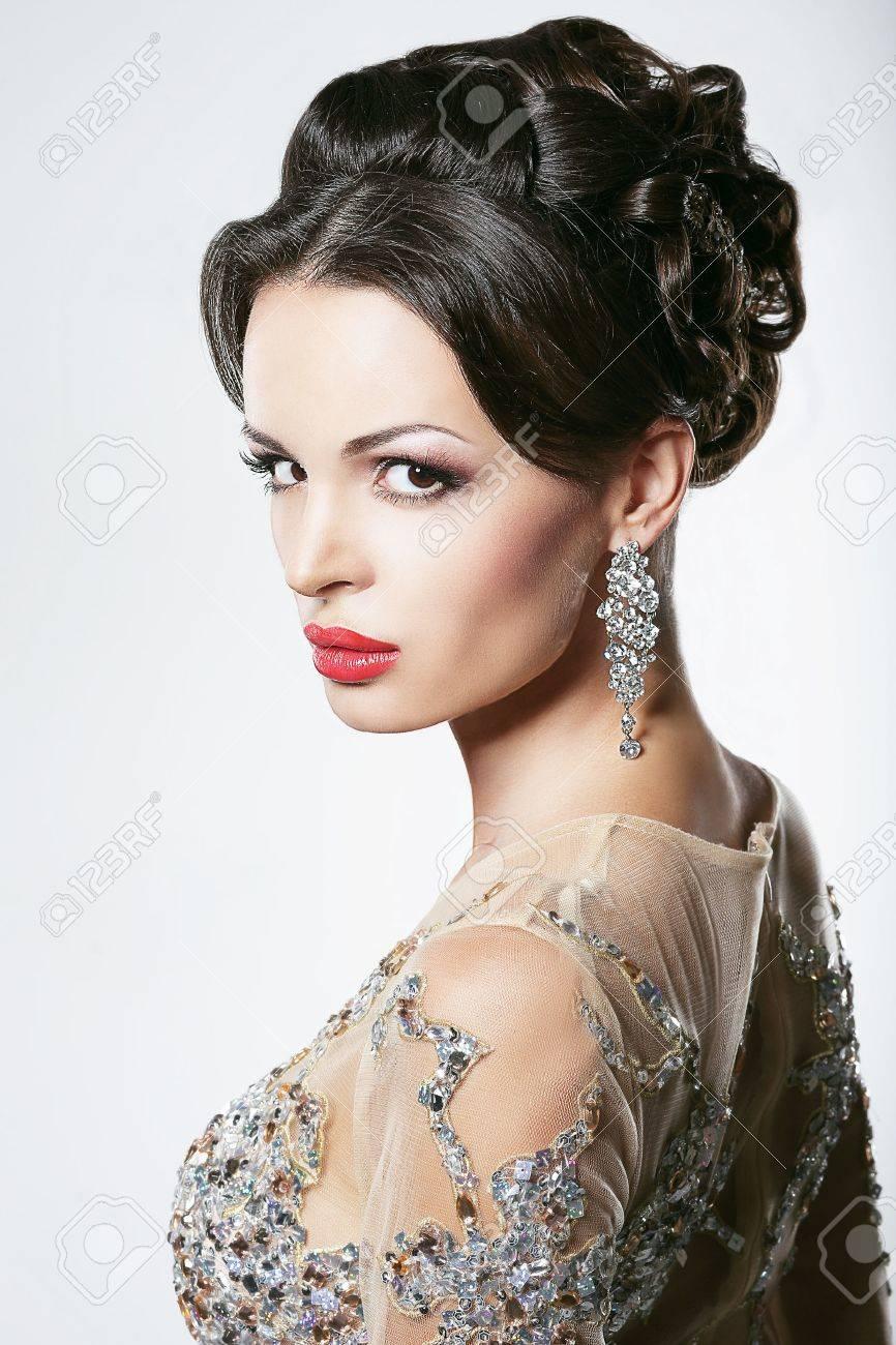 Prosperity  Luxury  Glamorous Showy Woman with Diamond Earrings Stock Photo - 22598010