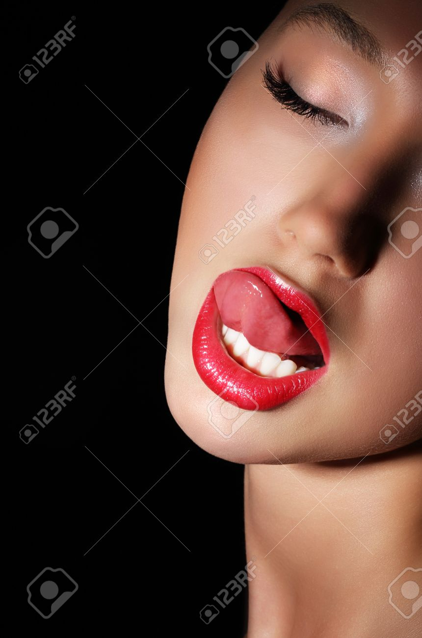 Provocative Woman Licking Her Red Sexy Lips Passion Stock Photo
