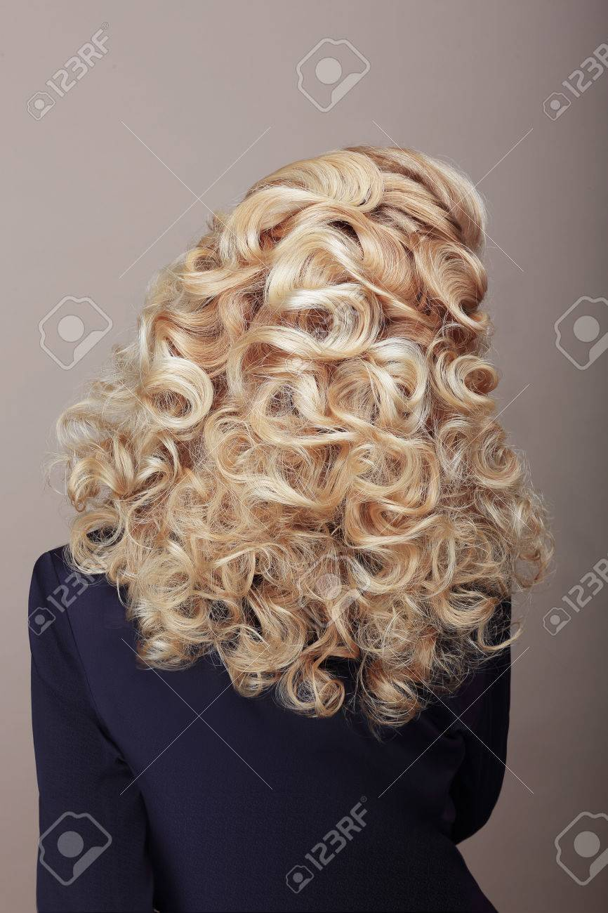 Rear View of Woman with Frizzy Ashen Hairs. Festive Braided Hairdo - 33339290