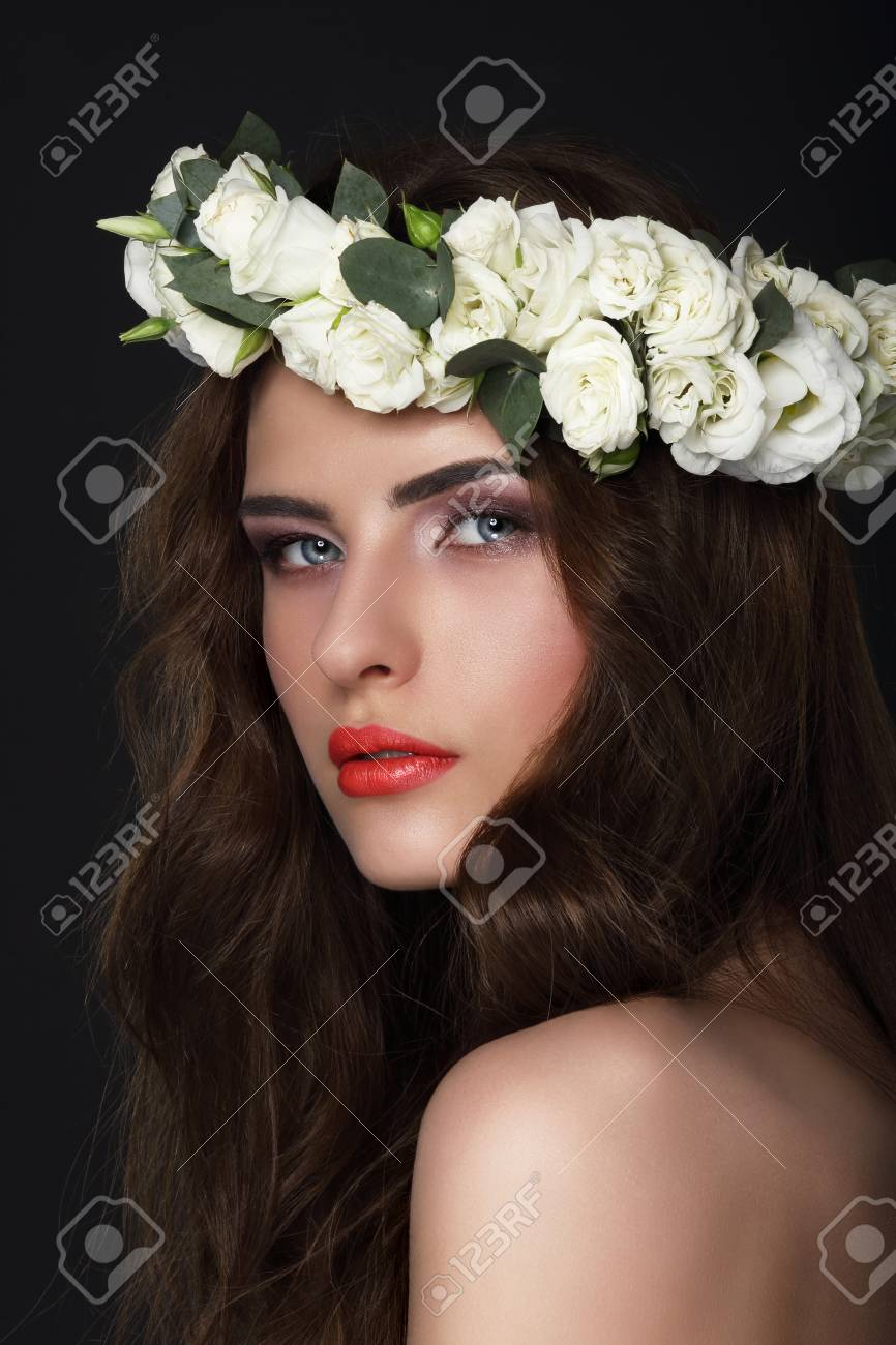 Sensuality. Young Brunette wearing Wreath of Roses - 34111089