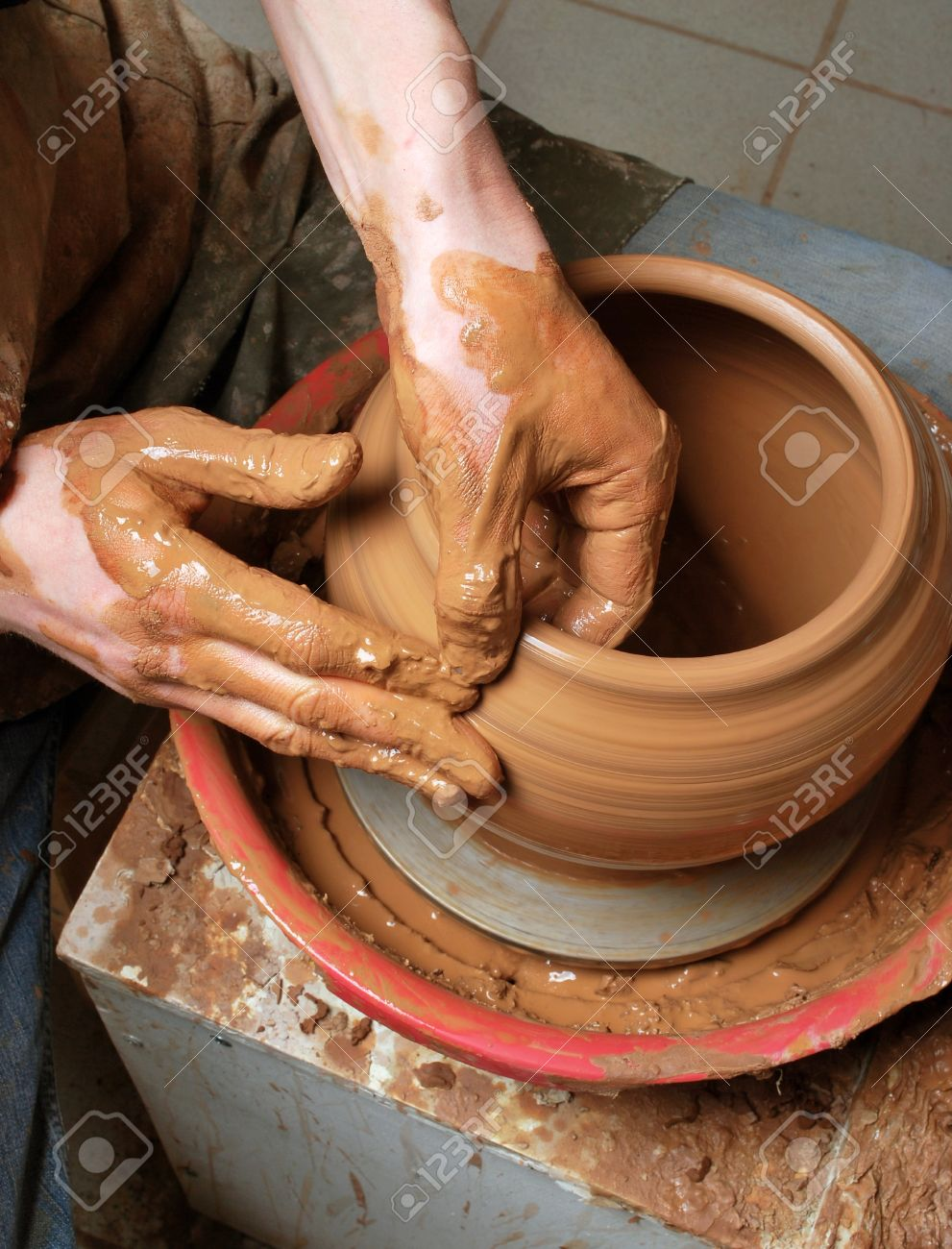 hands of a potter, creating an earthen jar on the circle Stock Photo - 13458903