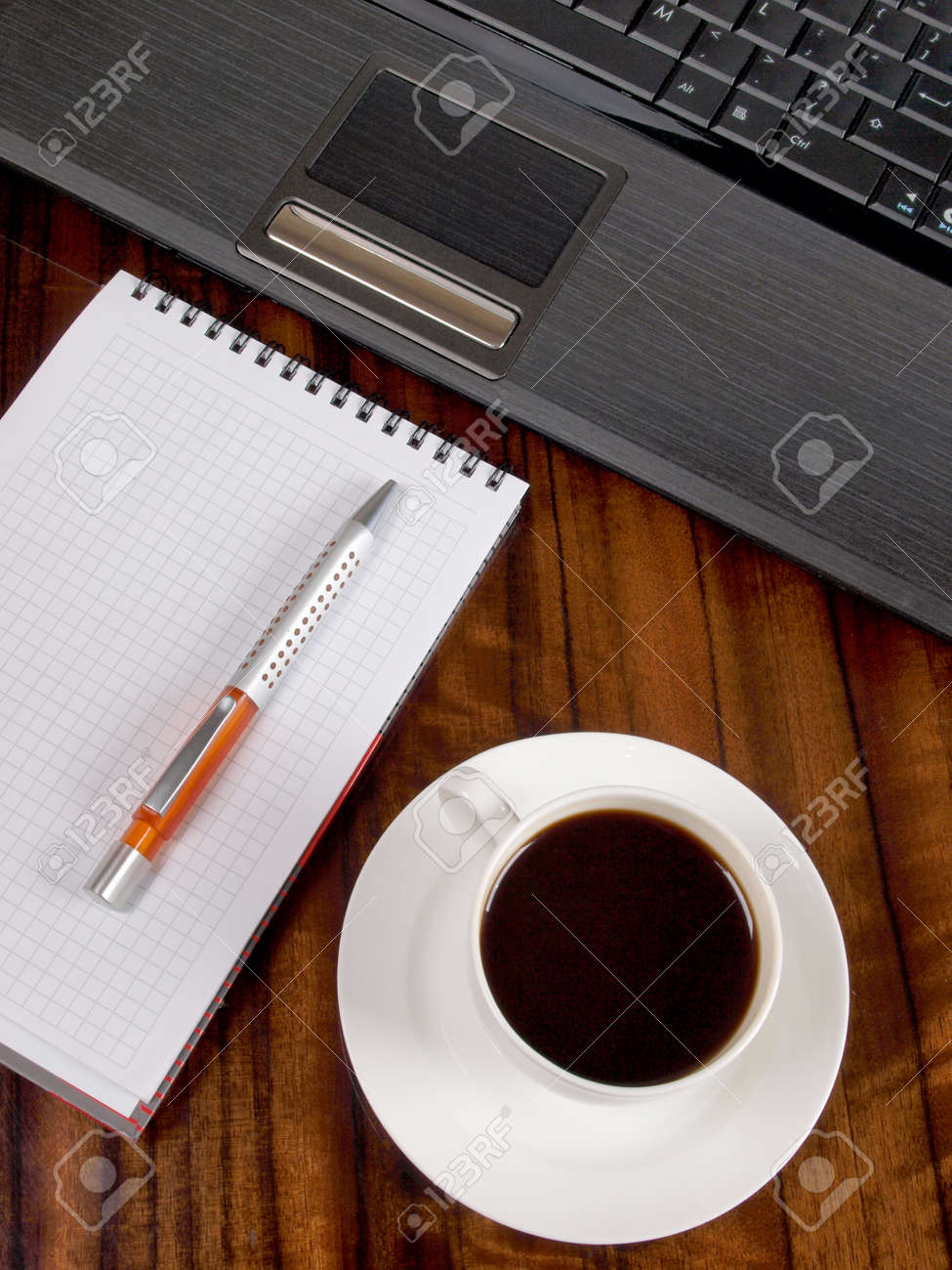 Color photo of a workplace with a laptop and a cup of coffee Stock Photo - 8661108