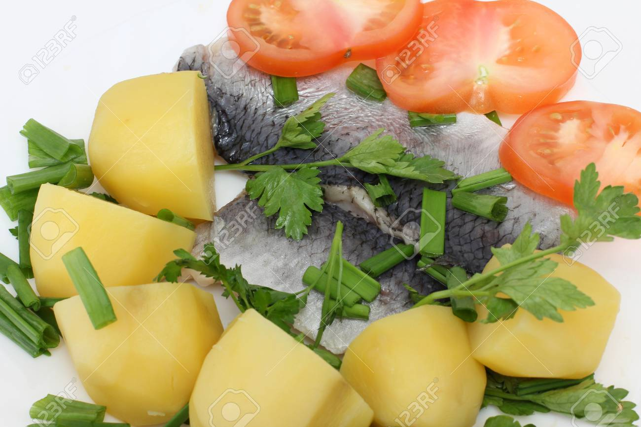 color photographs of salt herring and potatoes on a plate stock photo 13318435