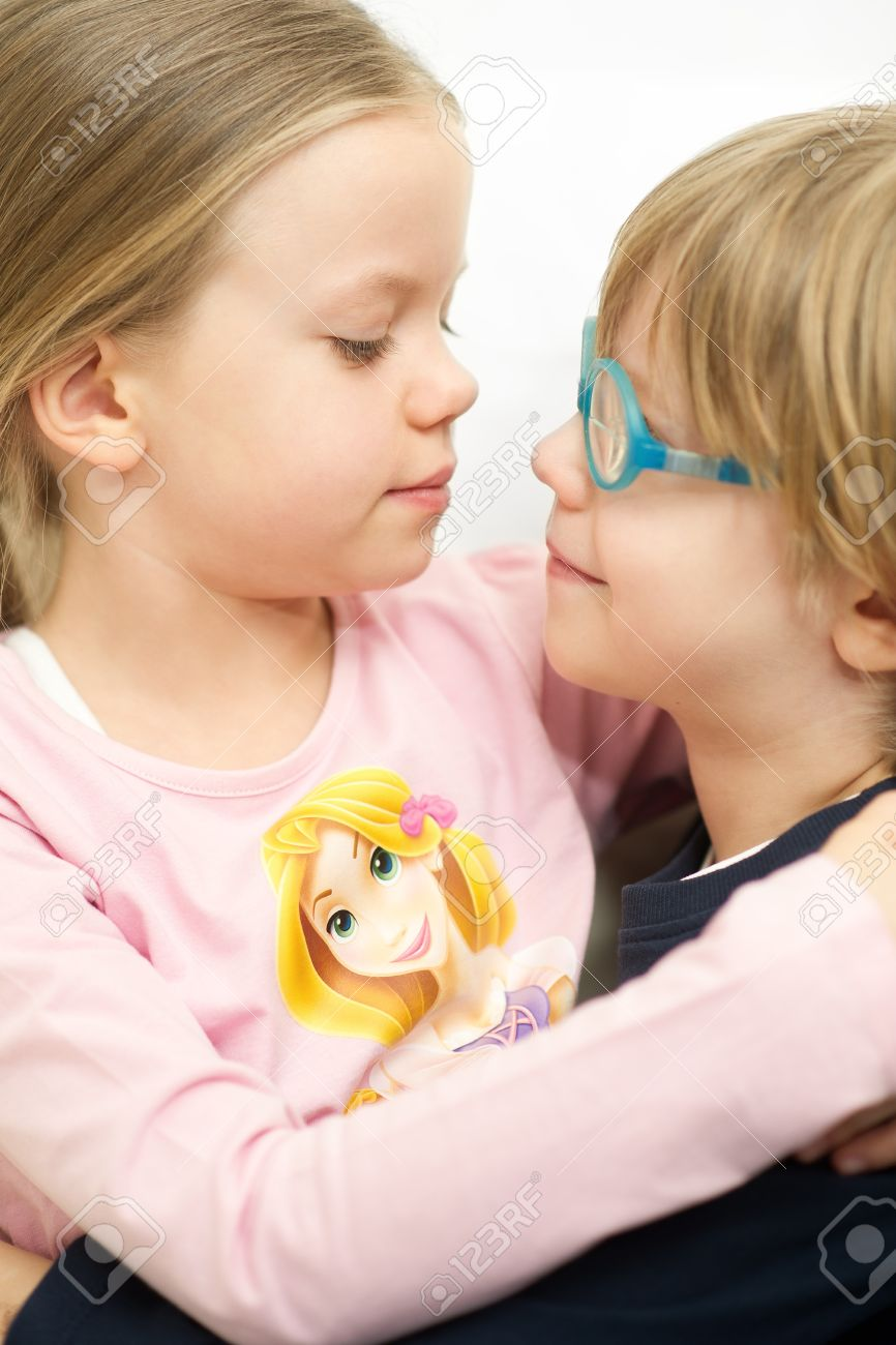 Little brother and sister holding and kissing each other Stock Photo - 18267650