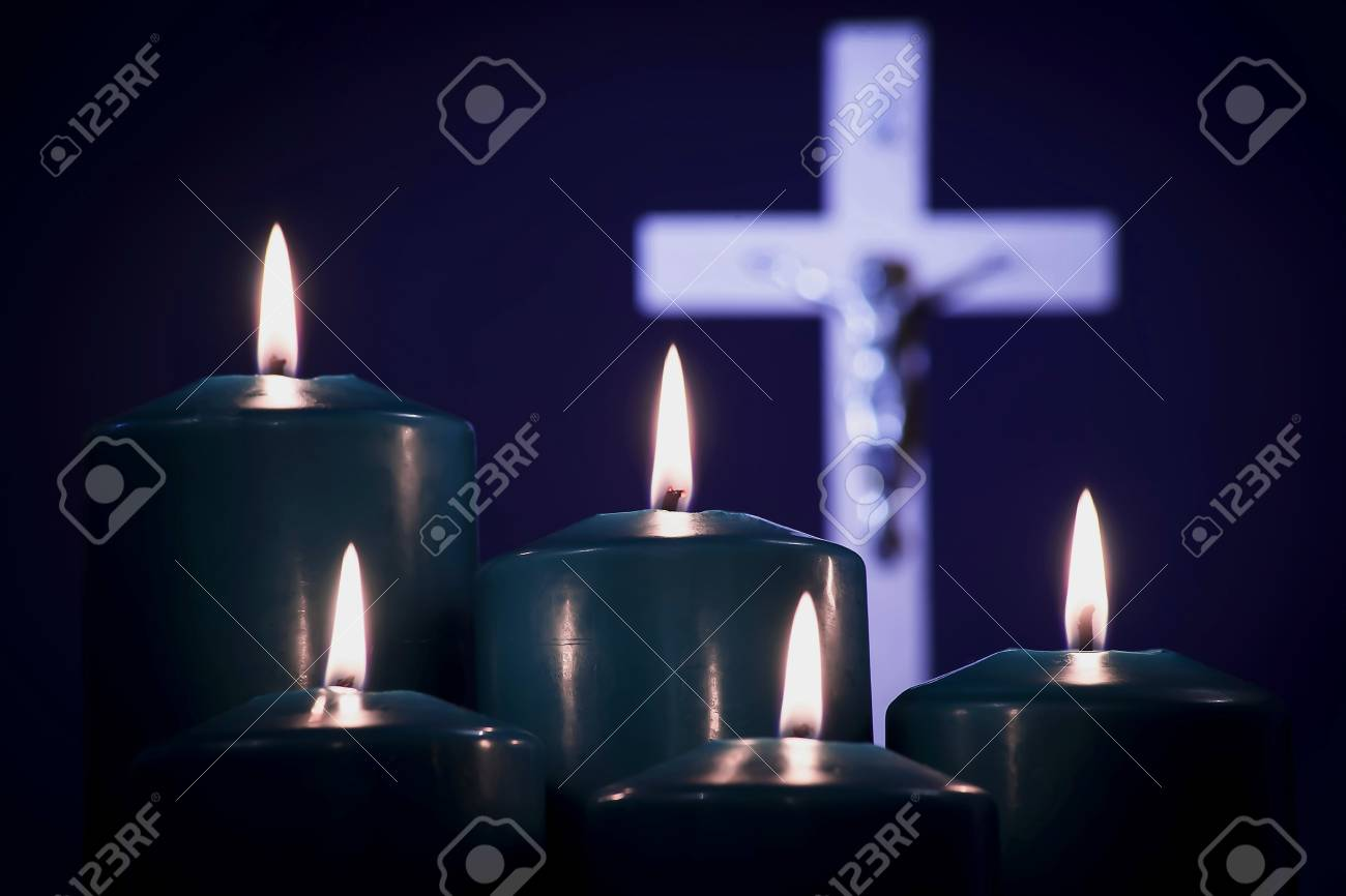 Lit candles on a white cross, on a blue background - 114900276