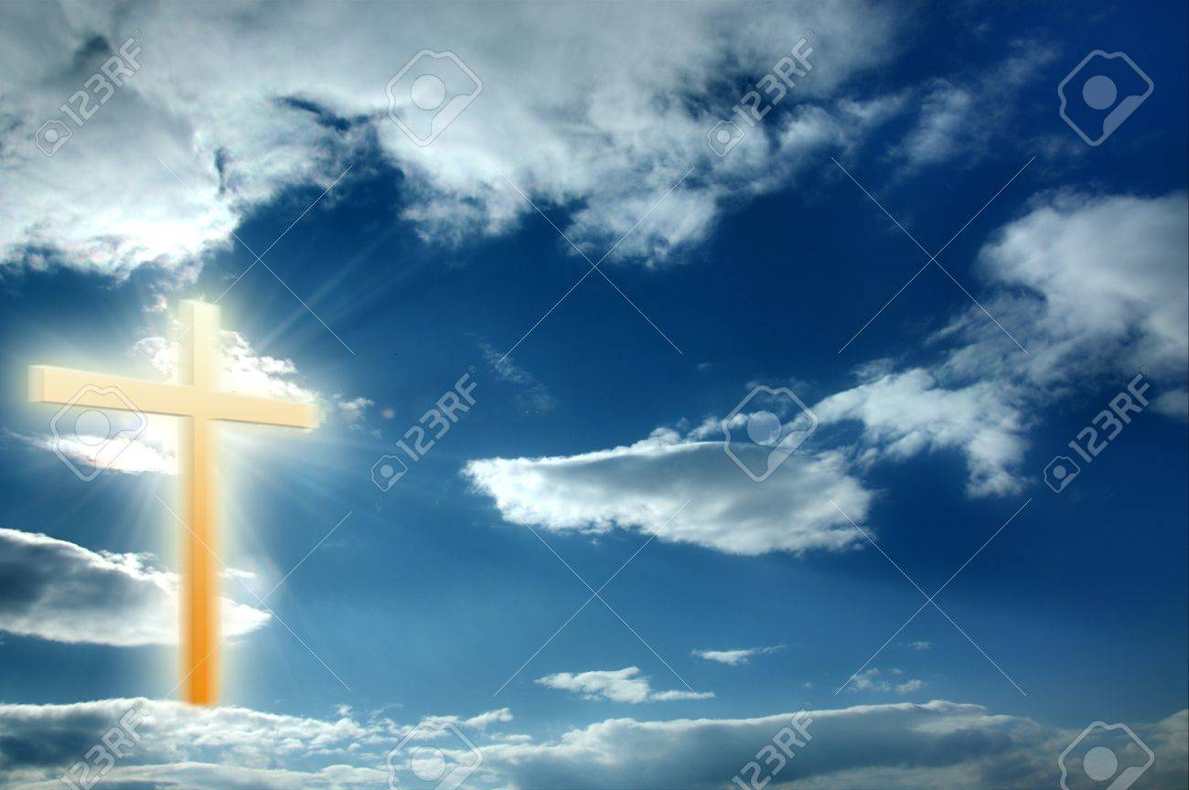 Religion cross on the blue sunny sky, heaven Stock Photo - 8821311