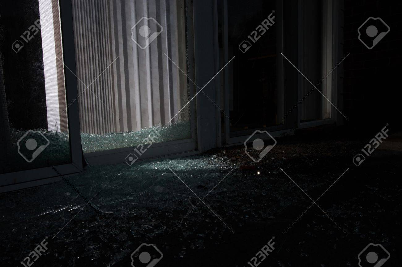 Broken sliding glass door at night use in a burglary stock photo broken sliding glass door at night use in a burglary stock photo 21453888 planetlyrics Image collections