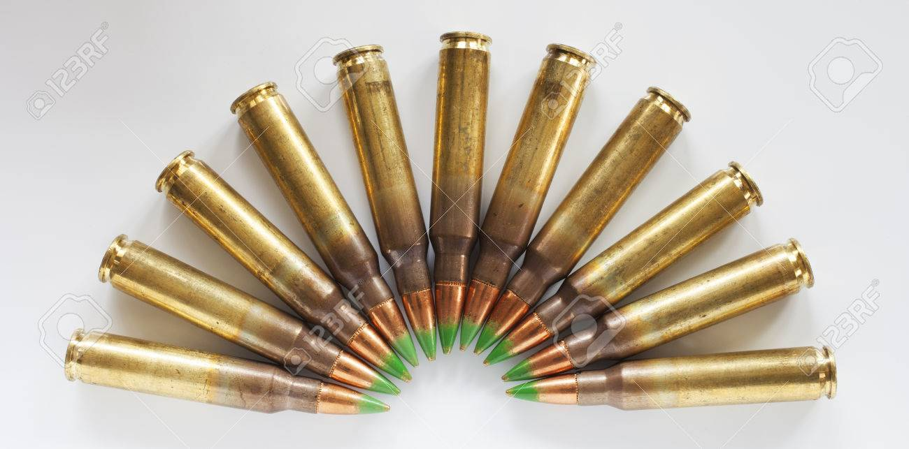 rifle ammunition with bullets that have a green tip in a semi