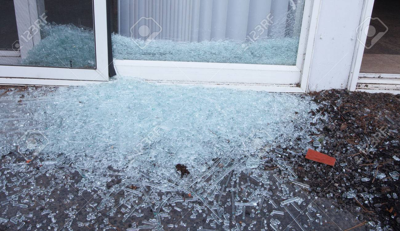 Sliding Glass Door That Has Been Shattered By A Criminal Stock Photo 56871466