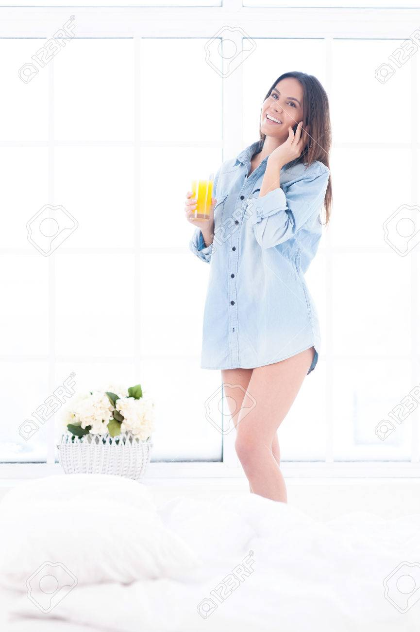 Calling To Say Good Morning Beautiful Young Woman In Blue Shirt