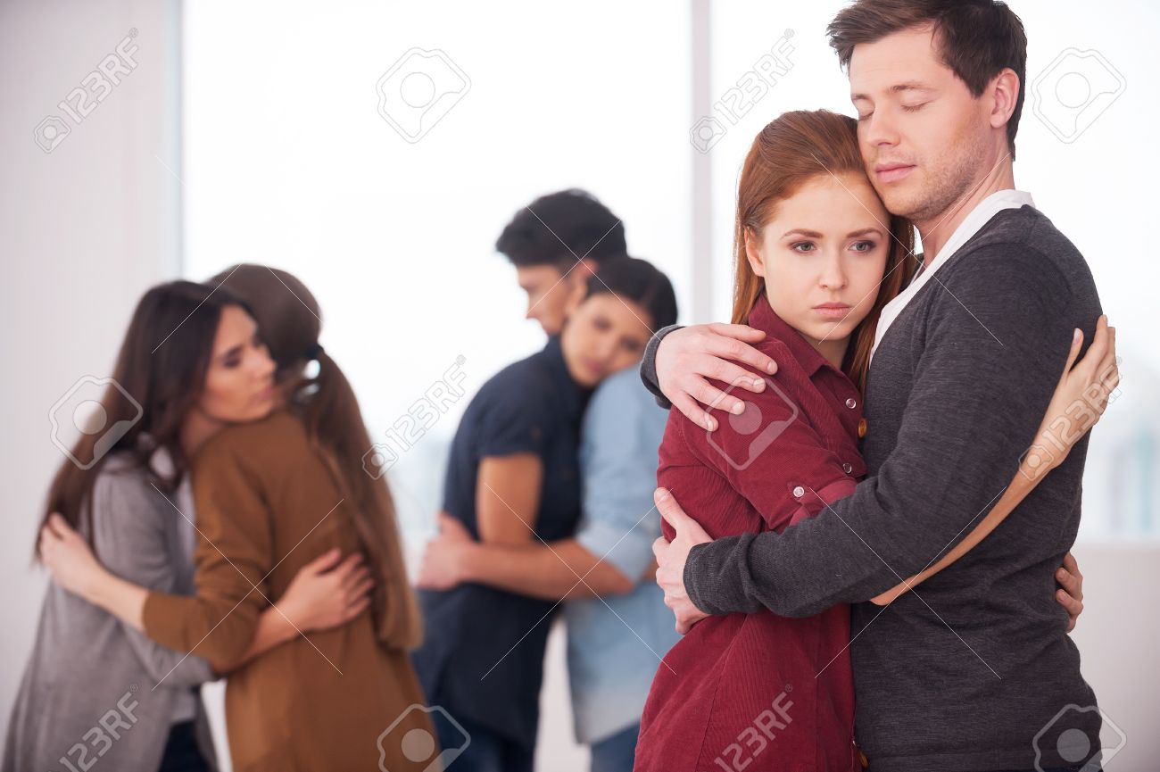 people we can trust group of depressed people hugging each other
